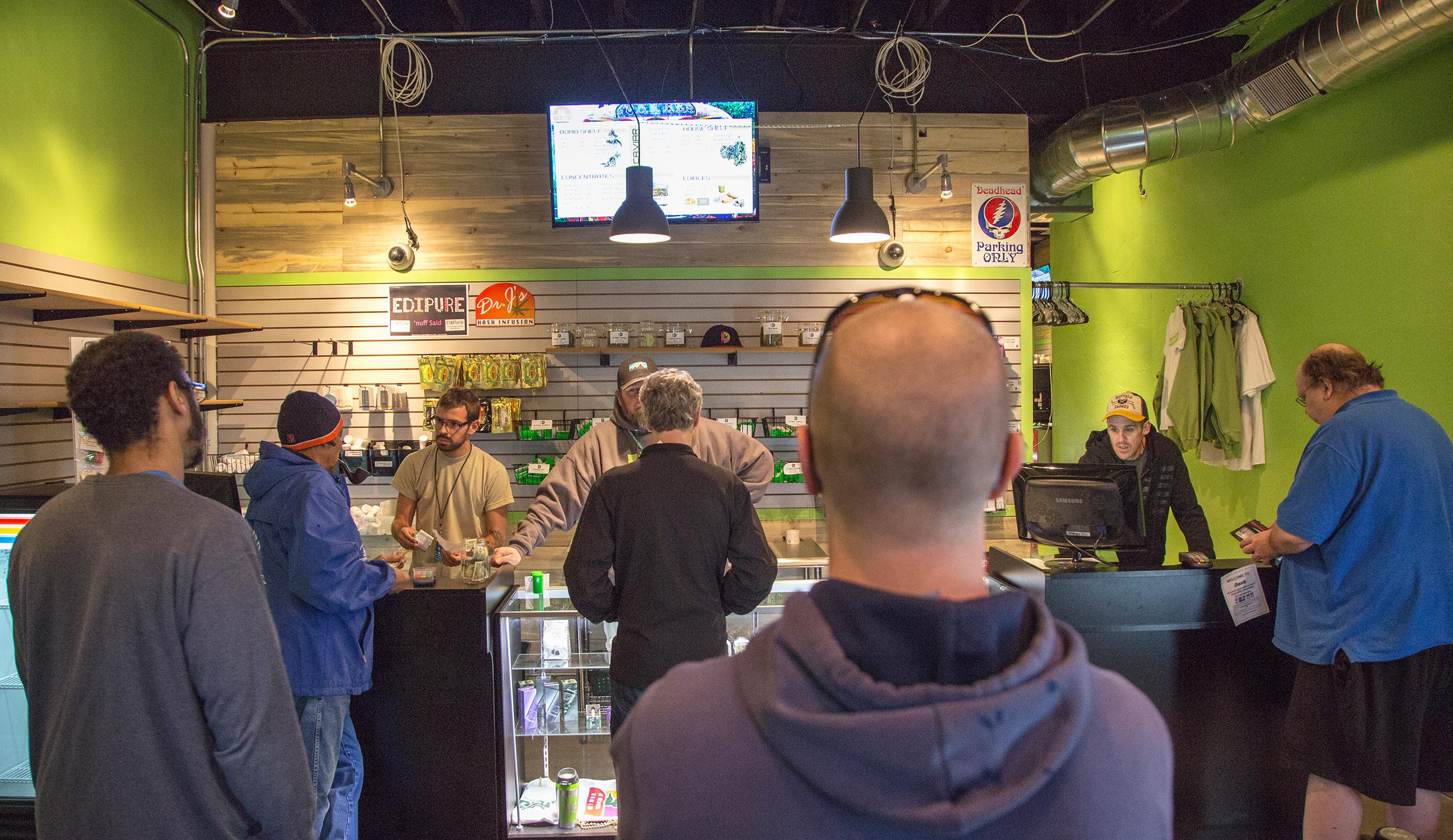 Image: Customers wait in line at the Dank Colorado Dispensary