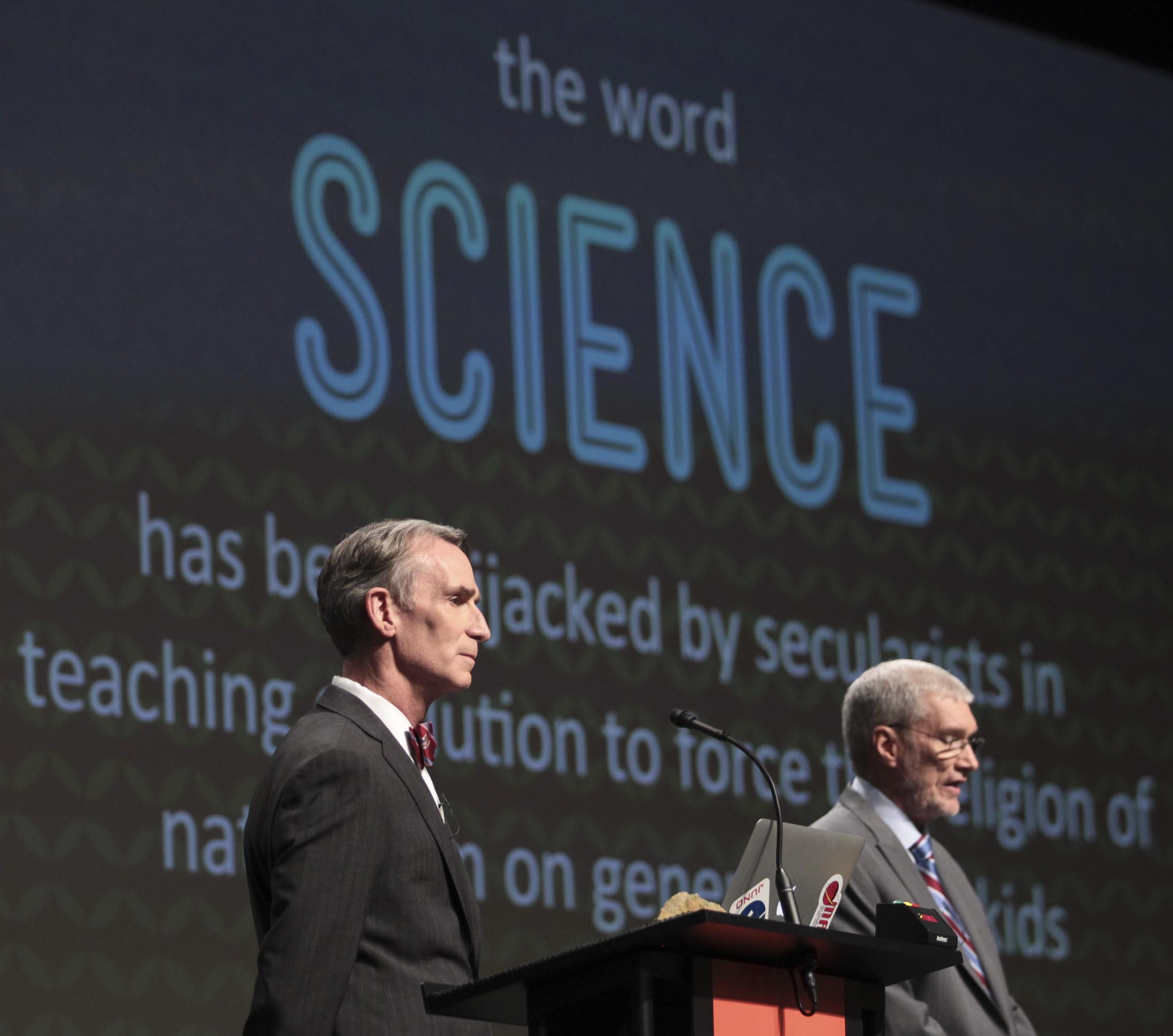 Image: Creation Museum head Ken Ham, right, speaks during a debate on evolution with TV's