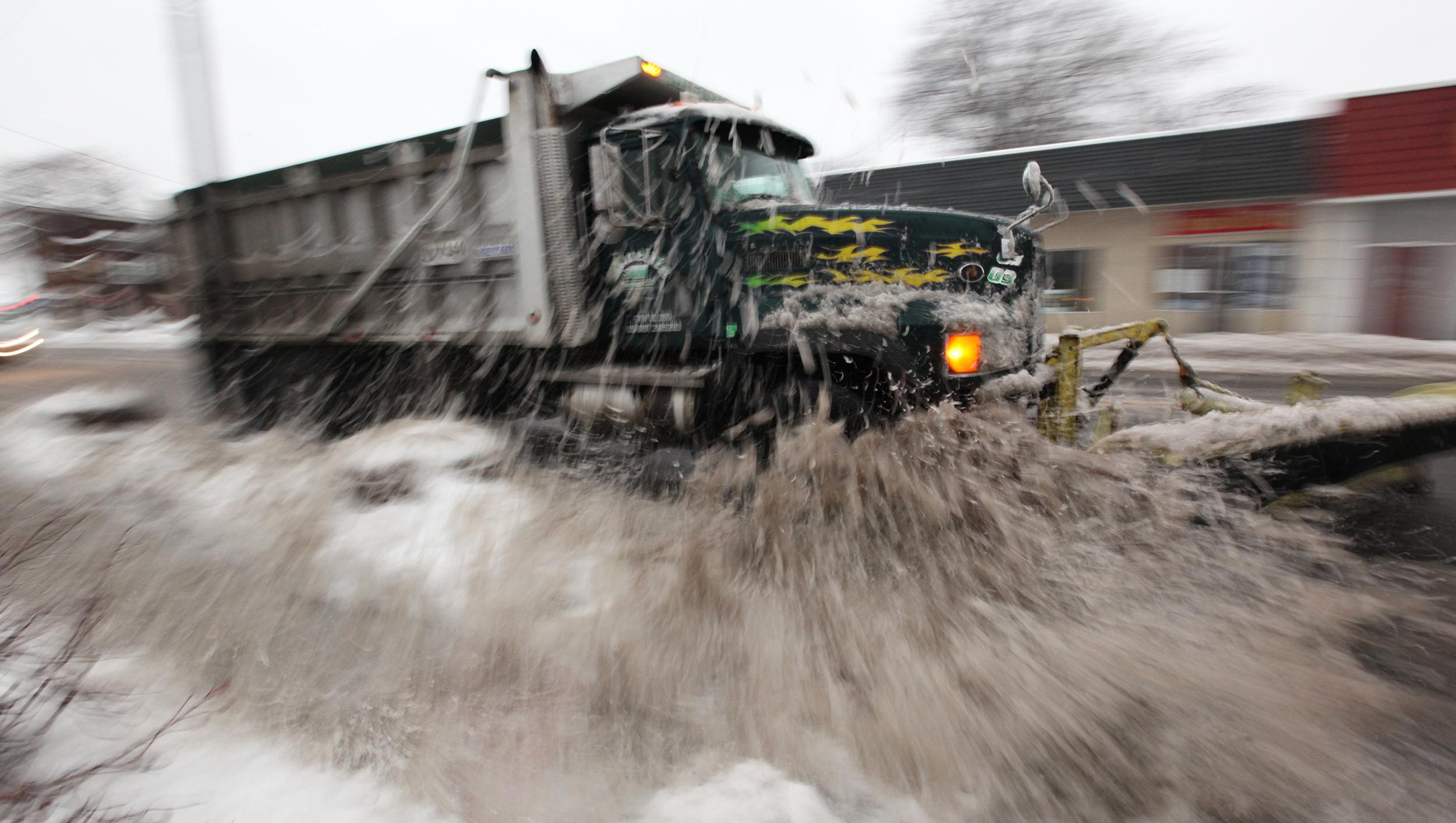 Image:  A plow cleans up North Ave. in Garwood, N.J.