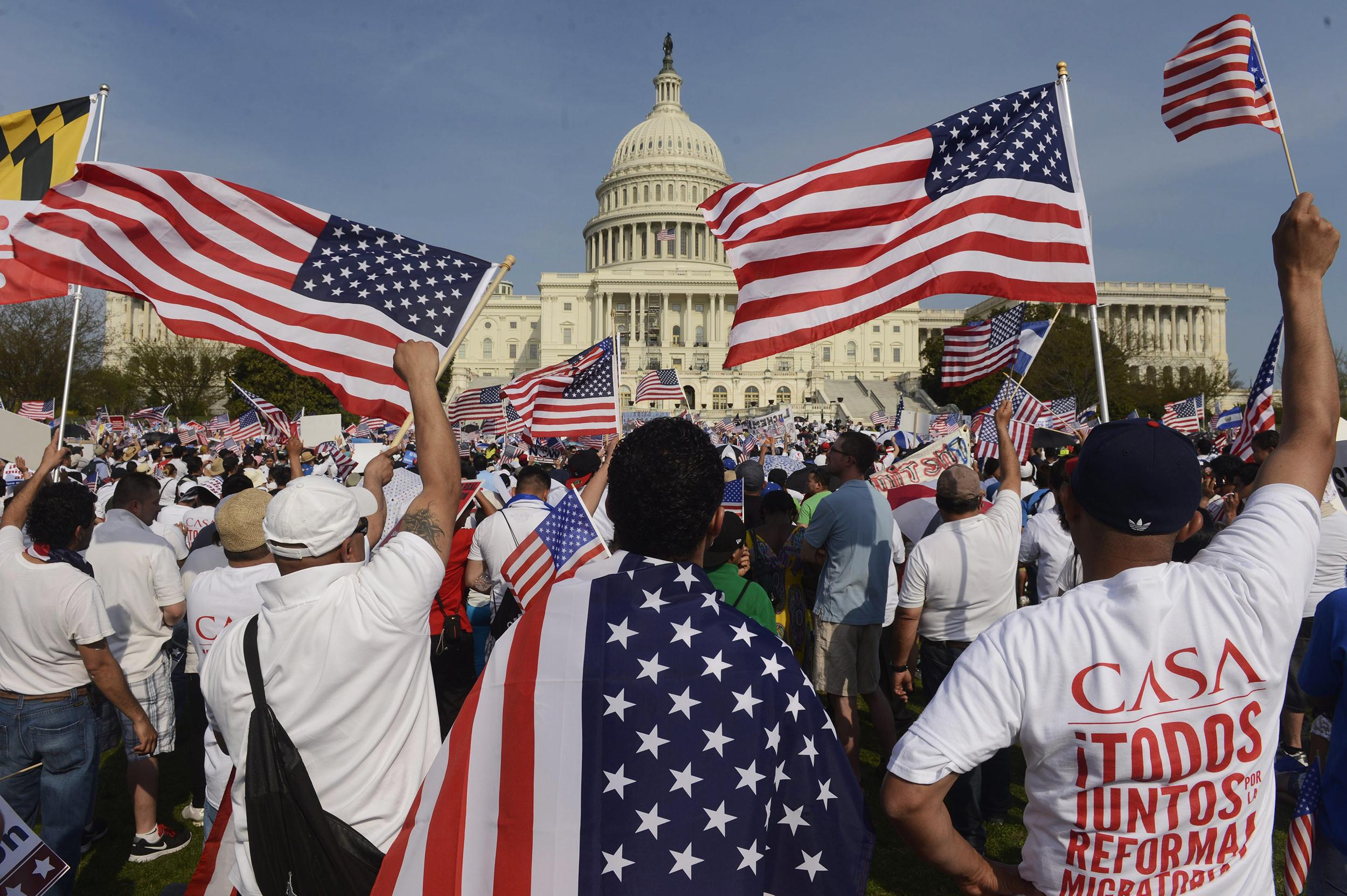 Image: People show their support during a rally for comprehensive immigration reform on the West Front of the US Capitol