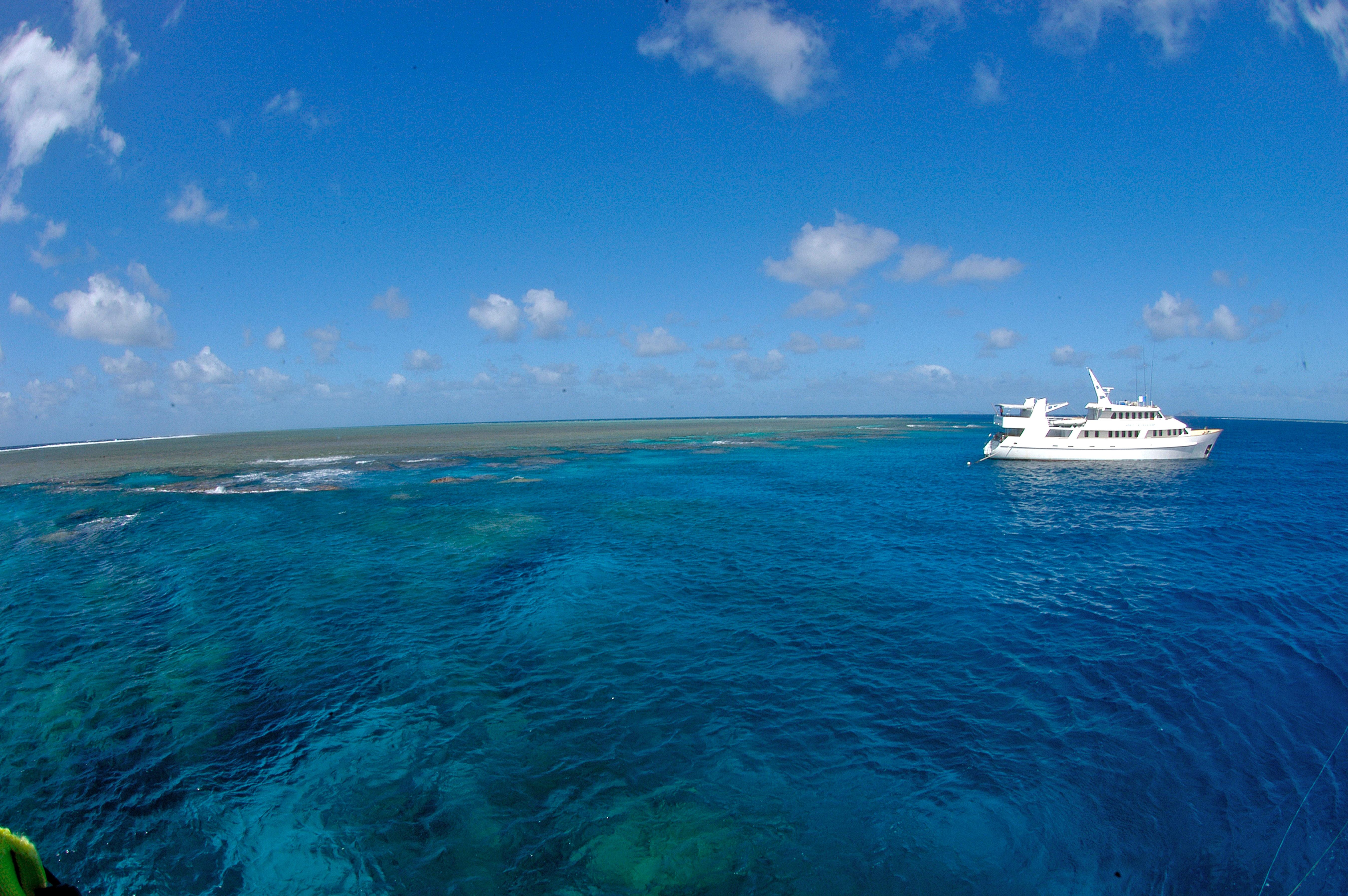 Image: A ship sails on the western Pacific Ocean near the Great Barrier Reef, Australia