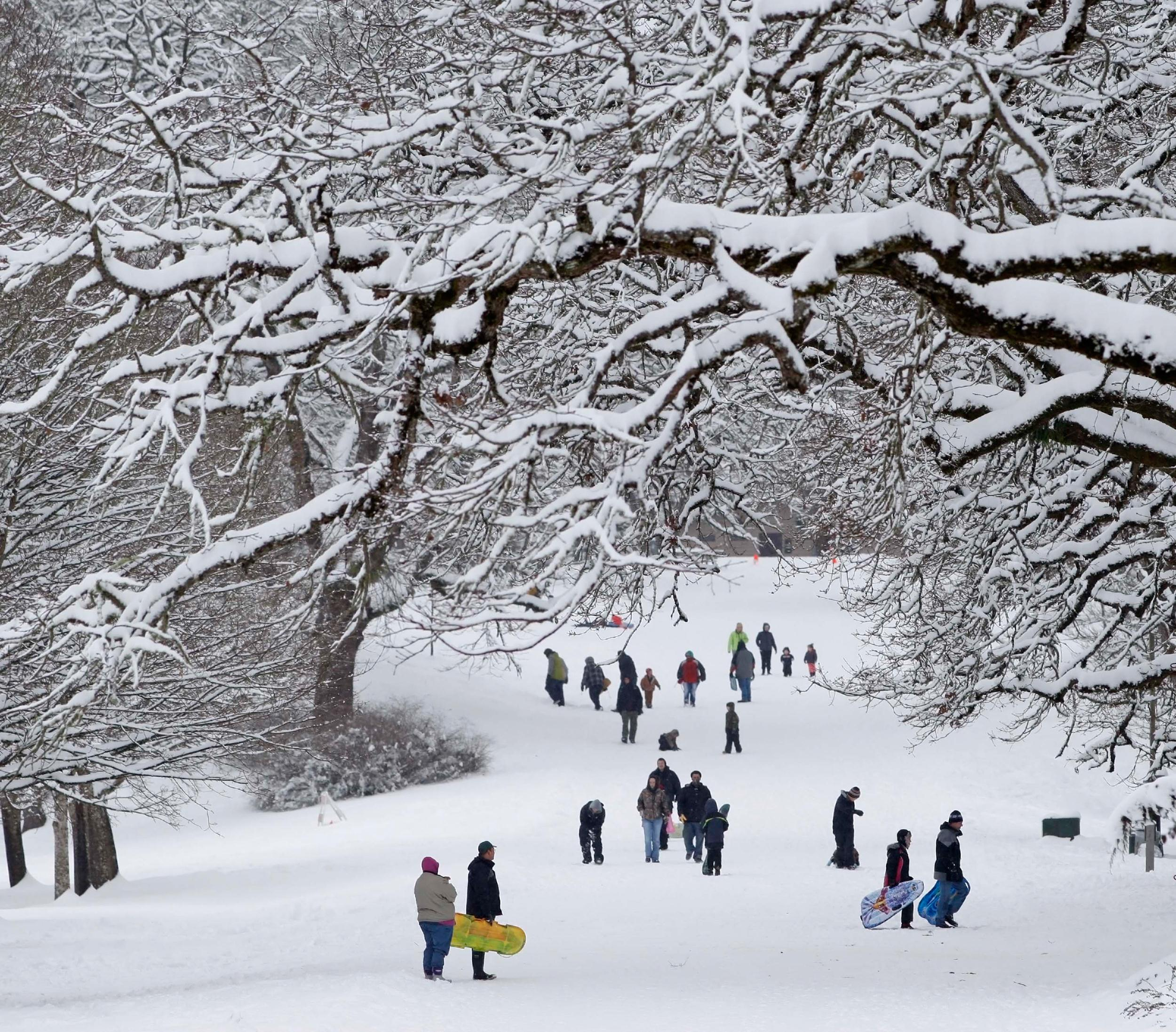 Image: People walk in the snow in Salem, Ore.