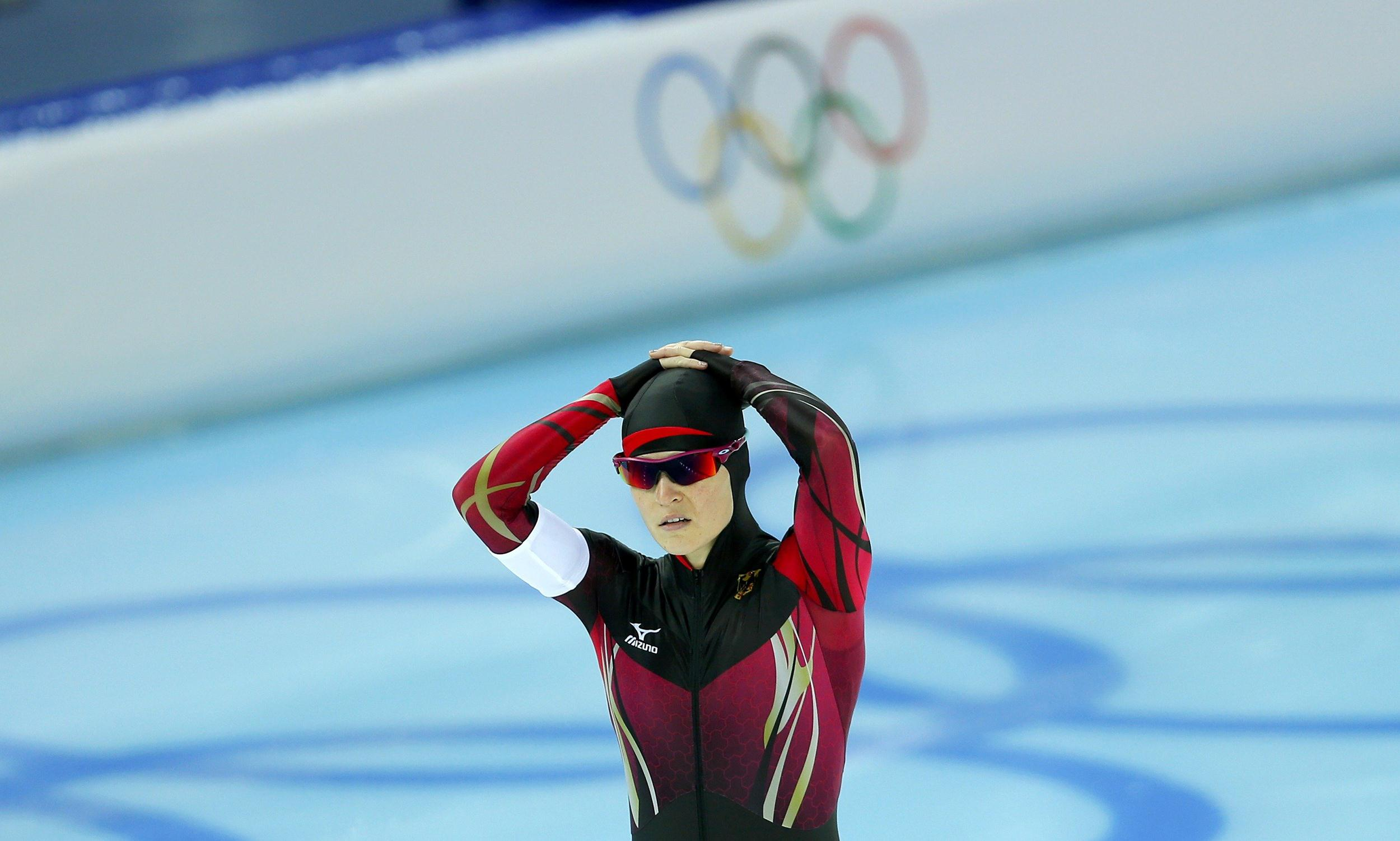 Image: Judith Hesse of Germany reacts after being disqualified for a second false start in race one of the women's 500 meters speed skating event during the 2014 Sochi Winter Olympics