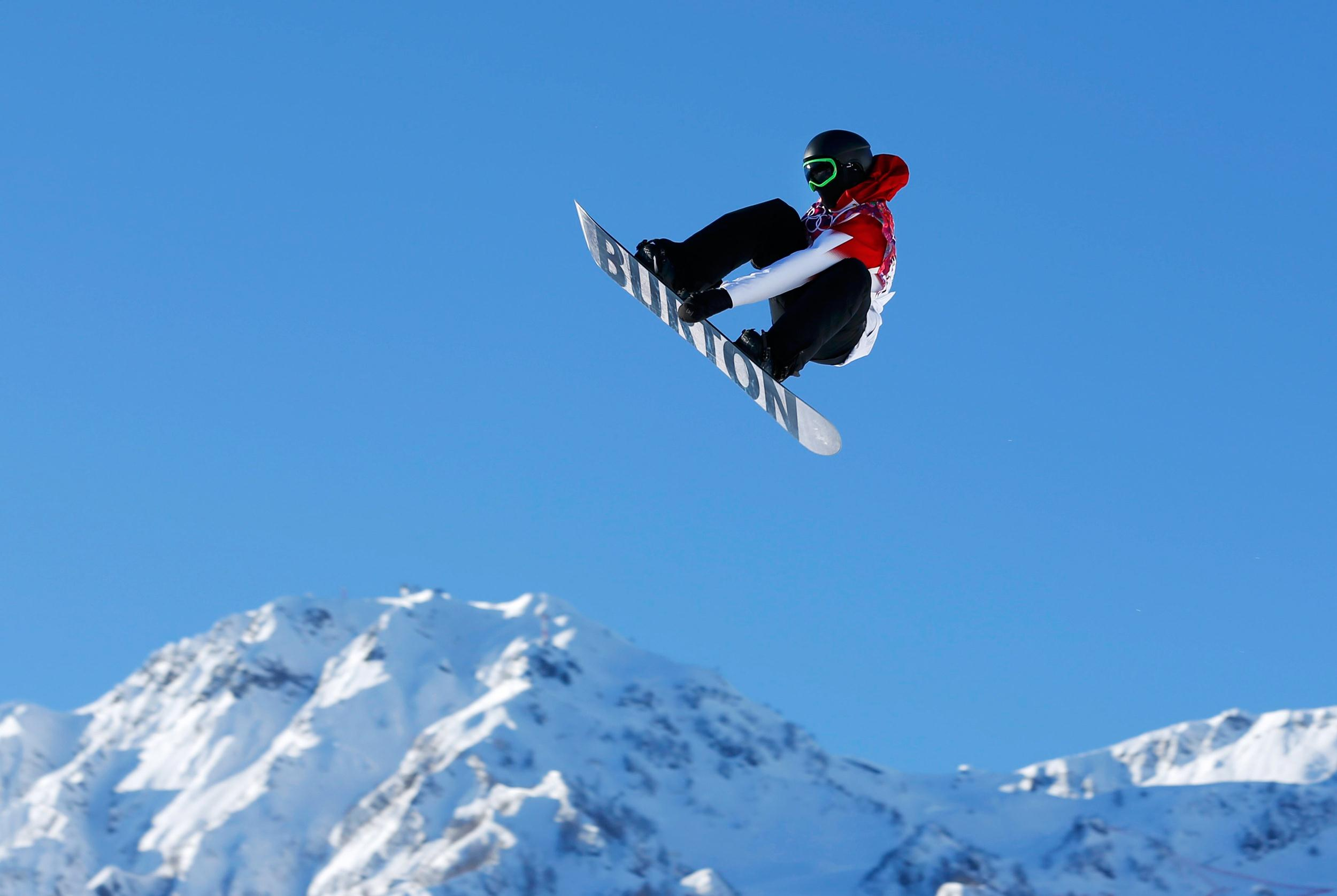 Image: Canadian snowboarder Mark McMorris spins off a jump during slopestyle snowboard training at the 2014 Sochi Winter Olympics in Rosa Khutor