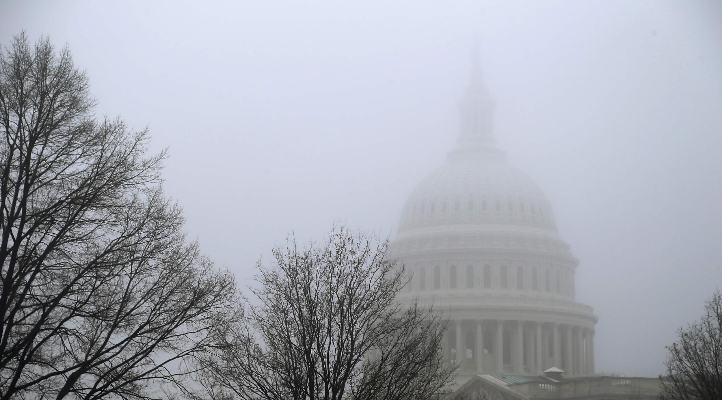Image: Morning mist covers the U.S. Capitol dome in Washington