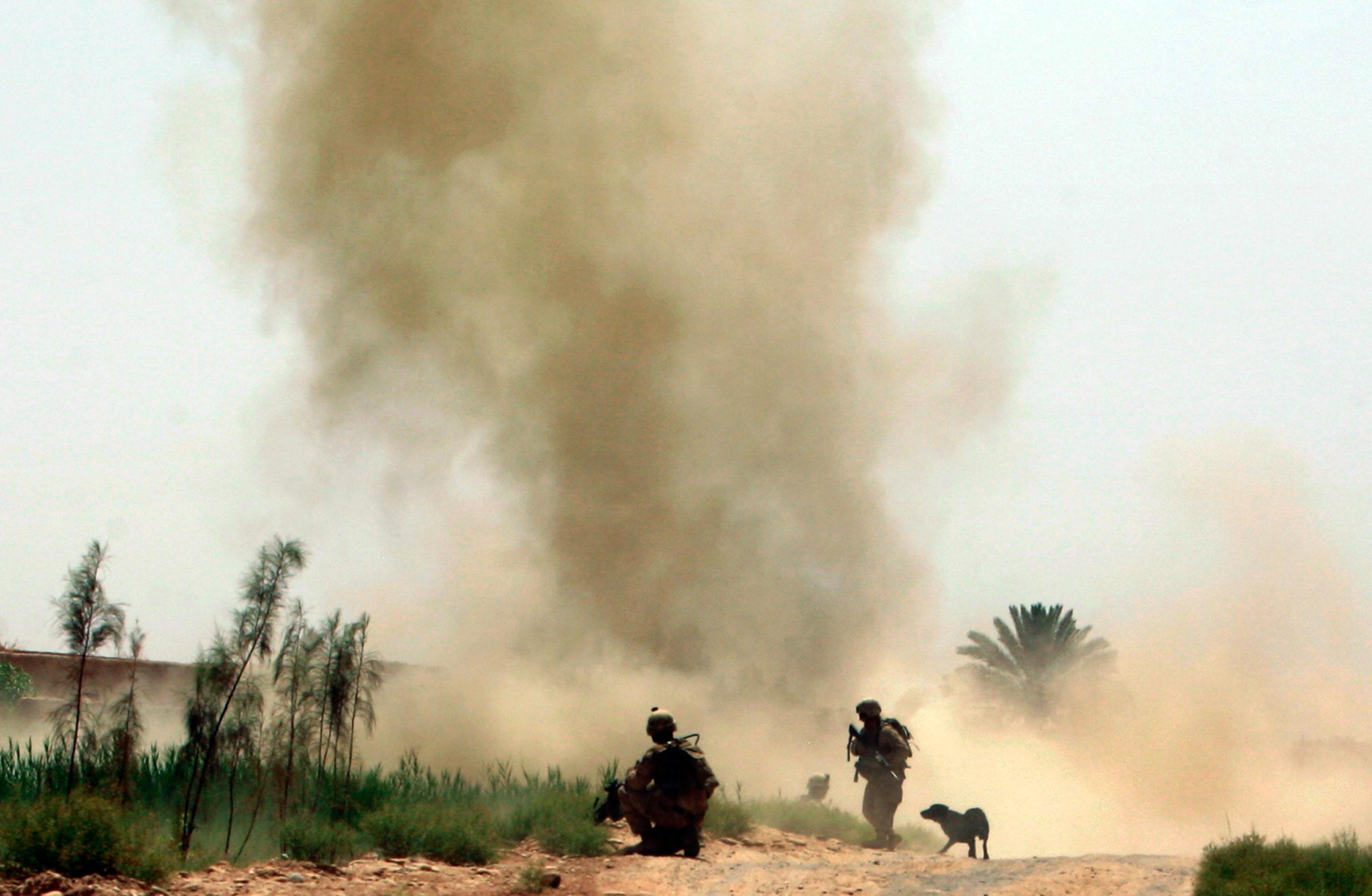 Image: U.S. Marines from 3rd Battalion, 6th Marines look on as an IED explodes while they are on a patrol in Marjah district
