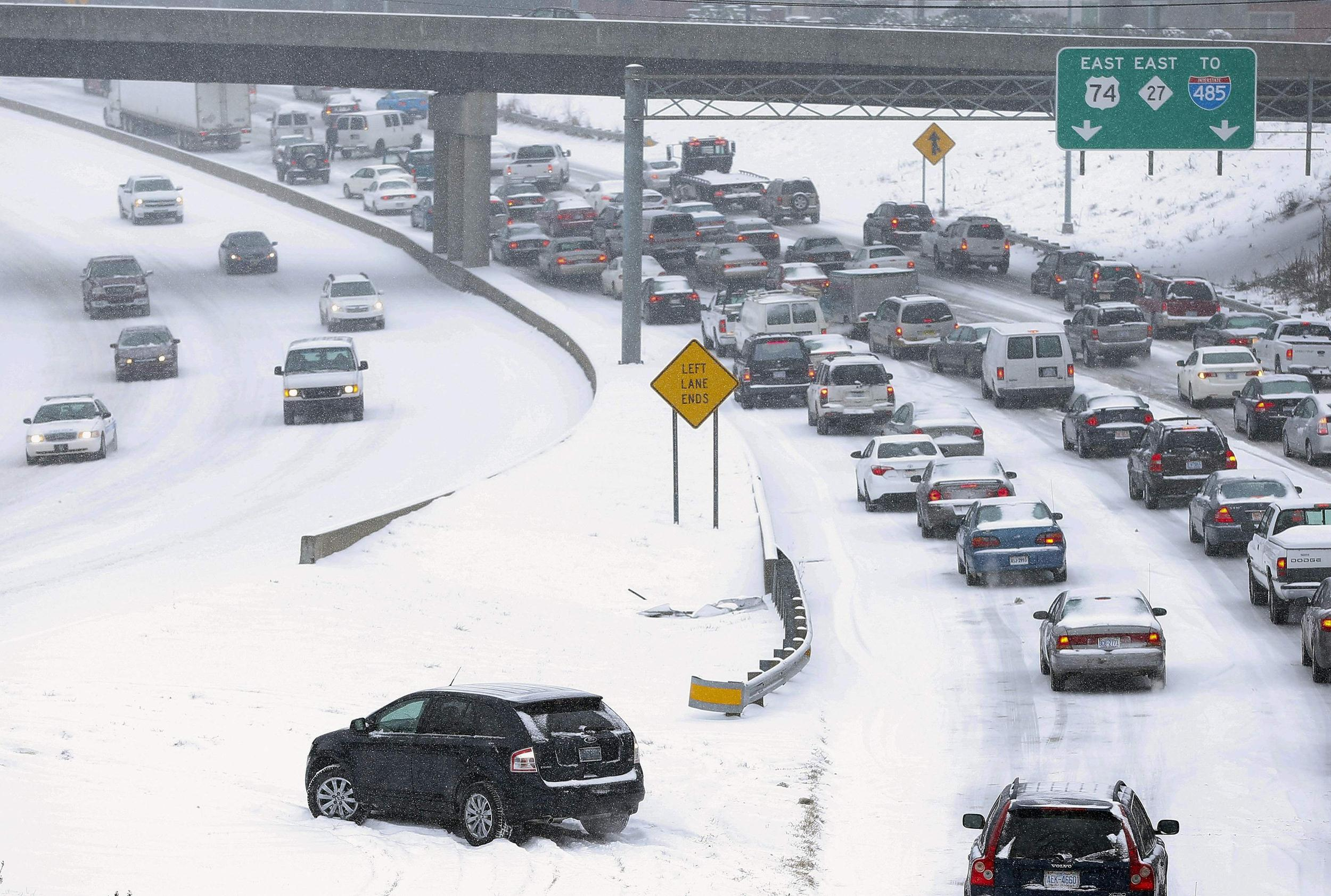 Image: Slow-moving motorists on a freeway leaving downtown Charlotte on Wednesday