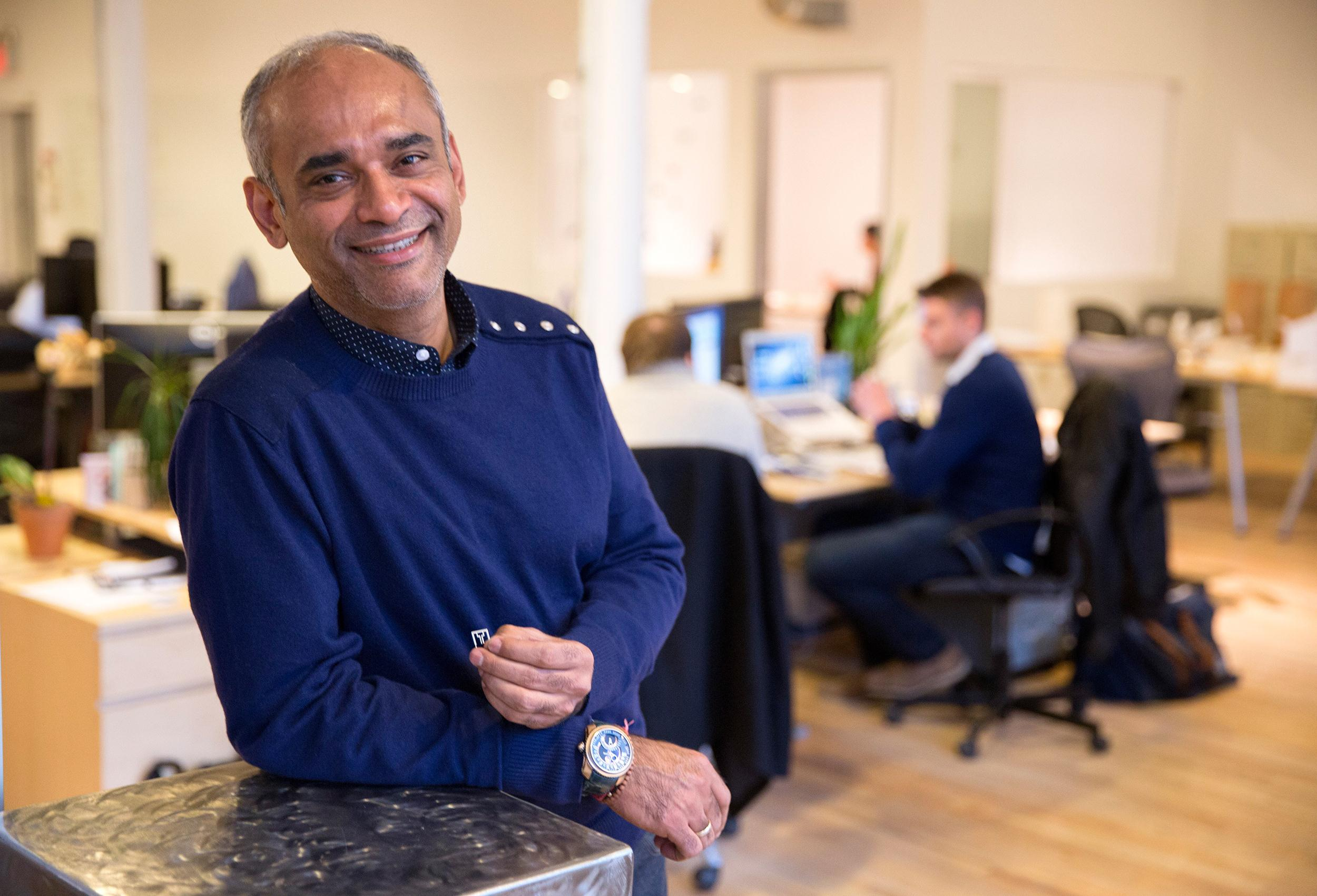 Image: Chet Kanojia, chief executive of Aereo, holds a tiny antenna designed to grab over-the-air television signals, at the company's office in New York.