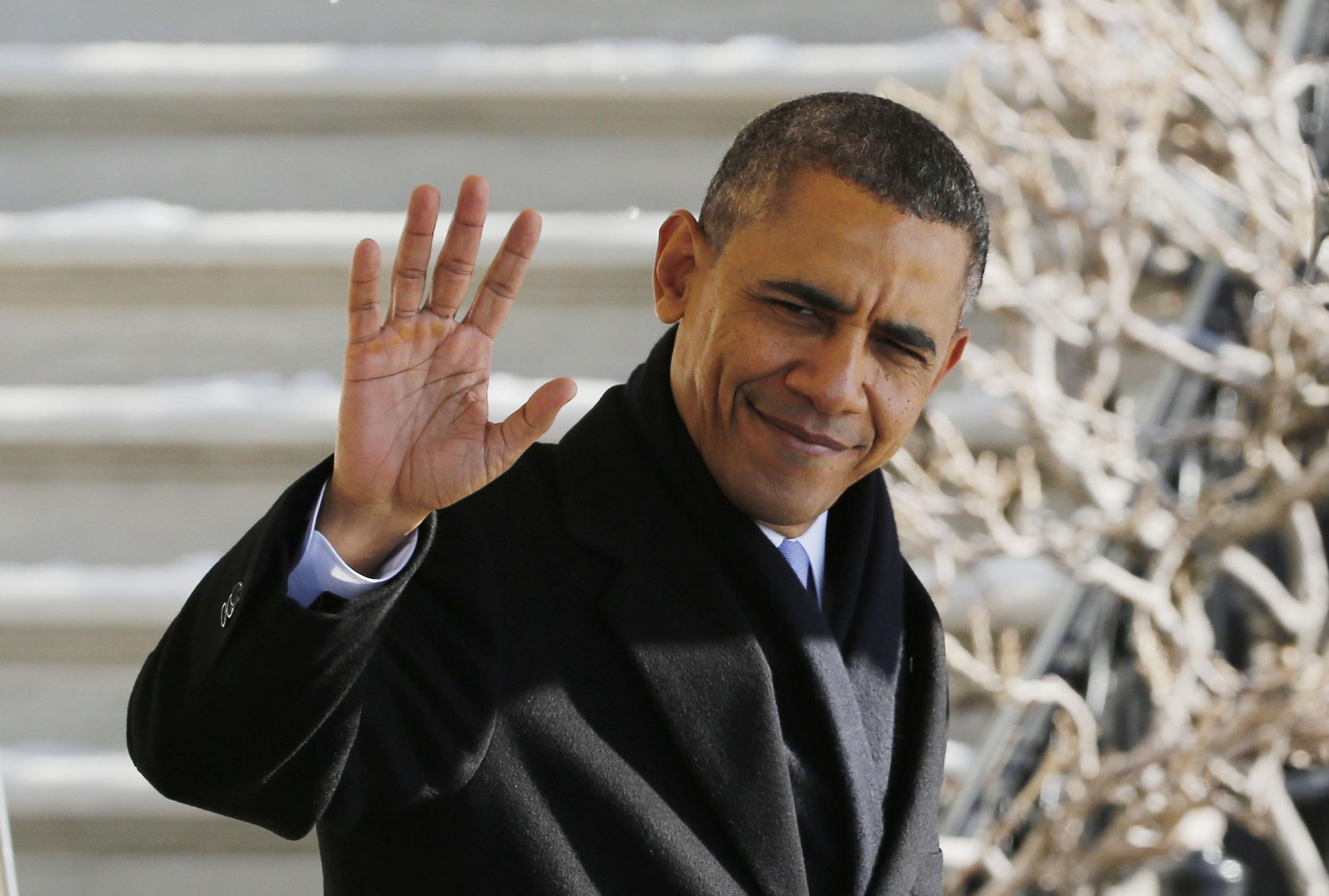 Image: U.S. President Barack Obama waves before departing the White House in Washington