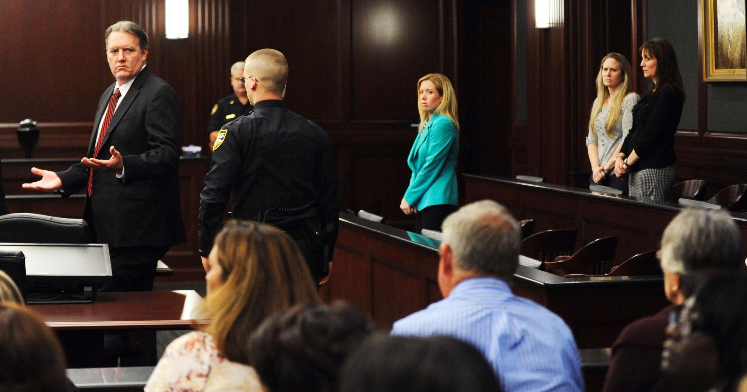 Image: Michael Dunn raises his hands in disbelief as he looks at his parents after the verdicts were announced in his trial in Jacksonville