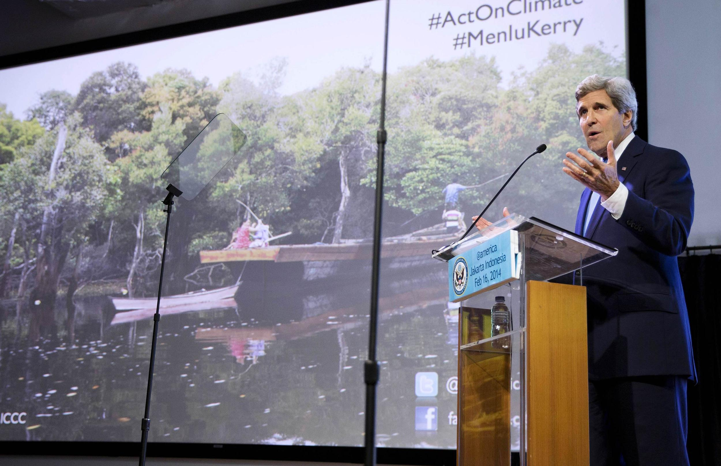 Image: U.S. Secretary of State Kerry gestures during a speech on climate change in Jakarta