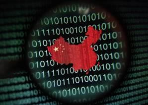 Image: A map of China is seen through a magnifying glass on a computer screen showing binary digits in Singapore in this January 2, 2014 photo illustration