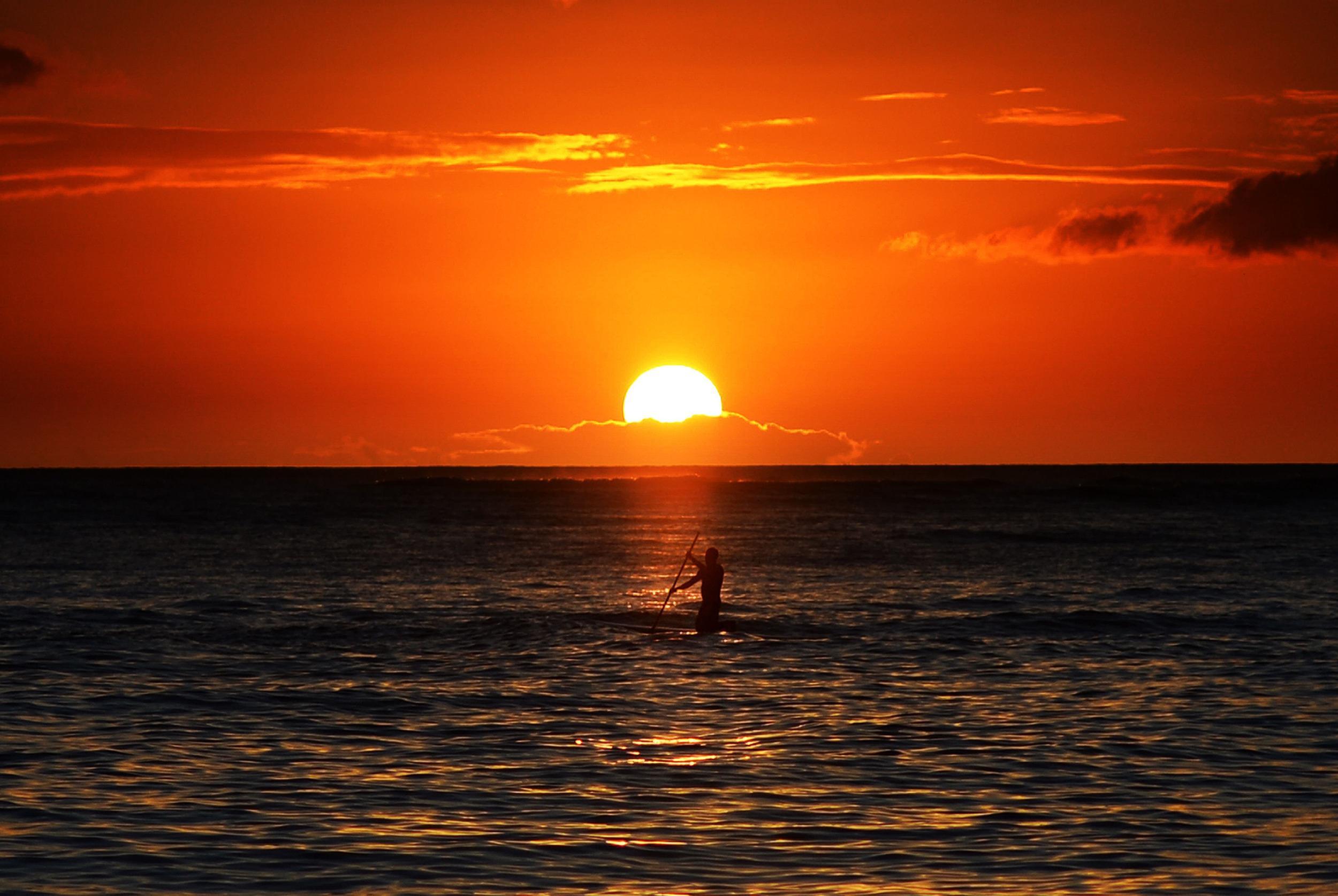 The sunset view from Waikiki beach in Honolulu, Hawaii