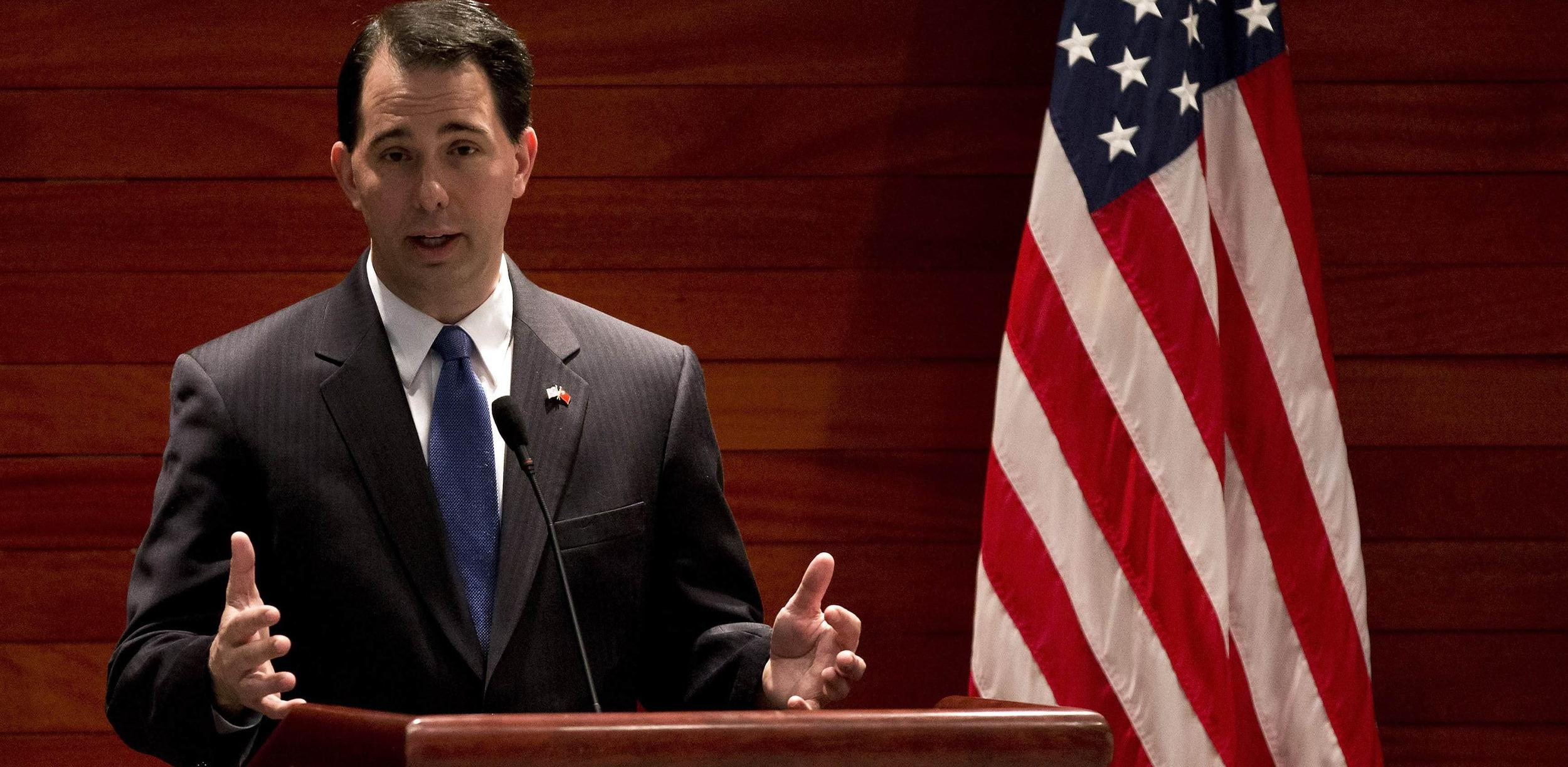 Image: File photo of Wisconsin Governor Scott Walker speaking after witnessing a signing memorandum of understanding of the commercial deals between U.S. and China at the U.S. Embassy in Beijing