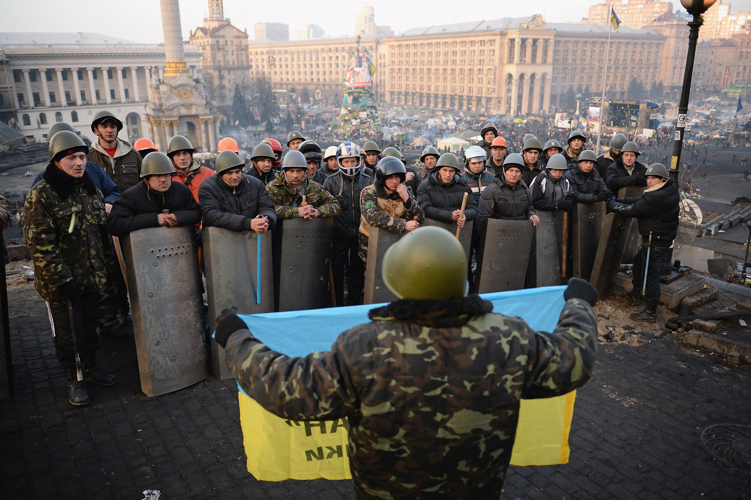 Image: Anti-government protesters man the barricades in Independence Square in Kiev on Friday.