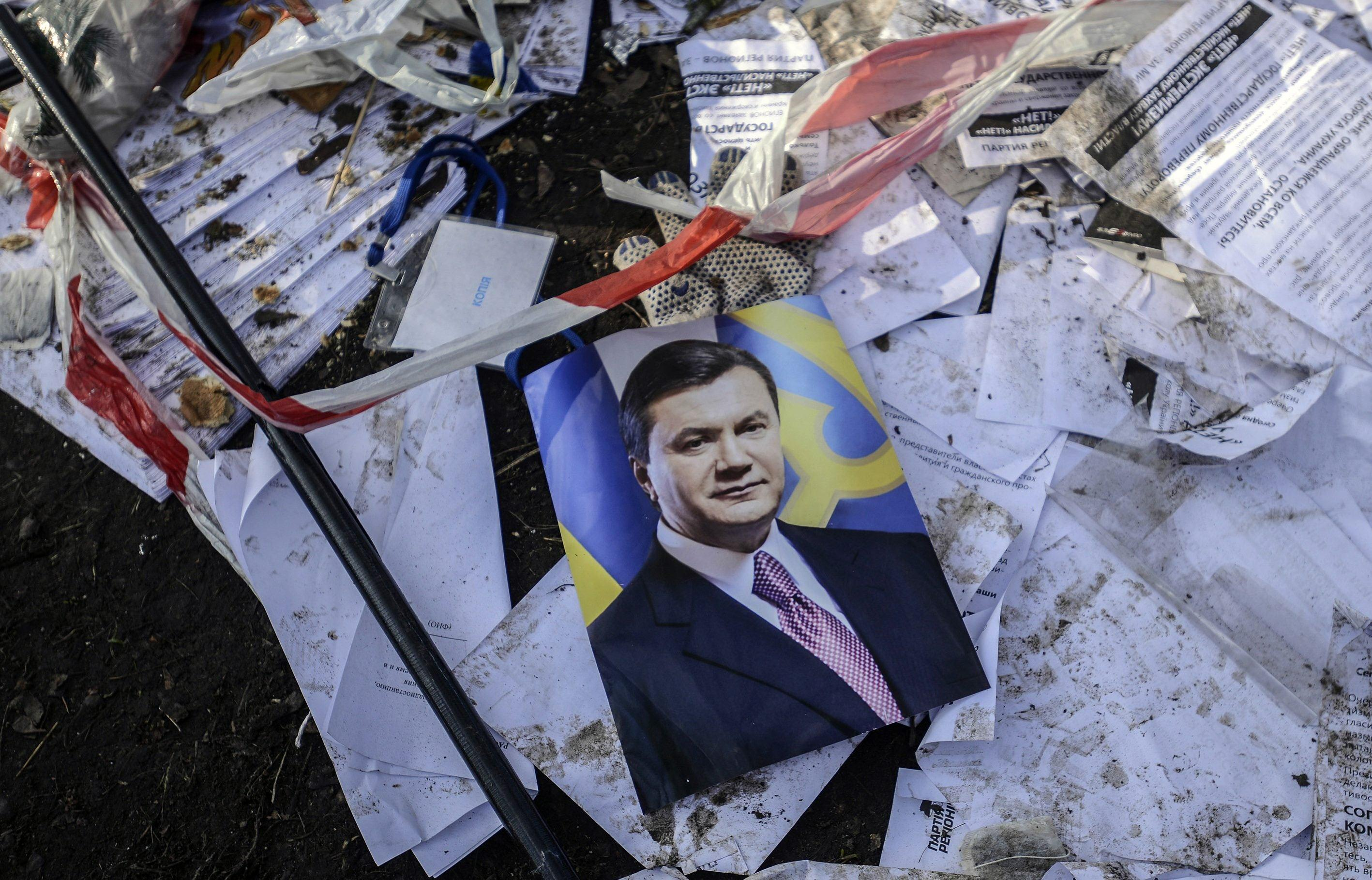 Image: A picture of Ukraine's President Viktor Yanukovich is seen on the ground in Kiev