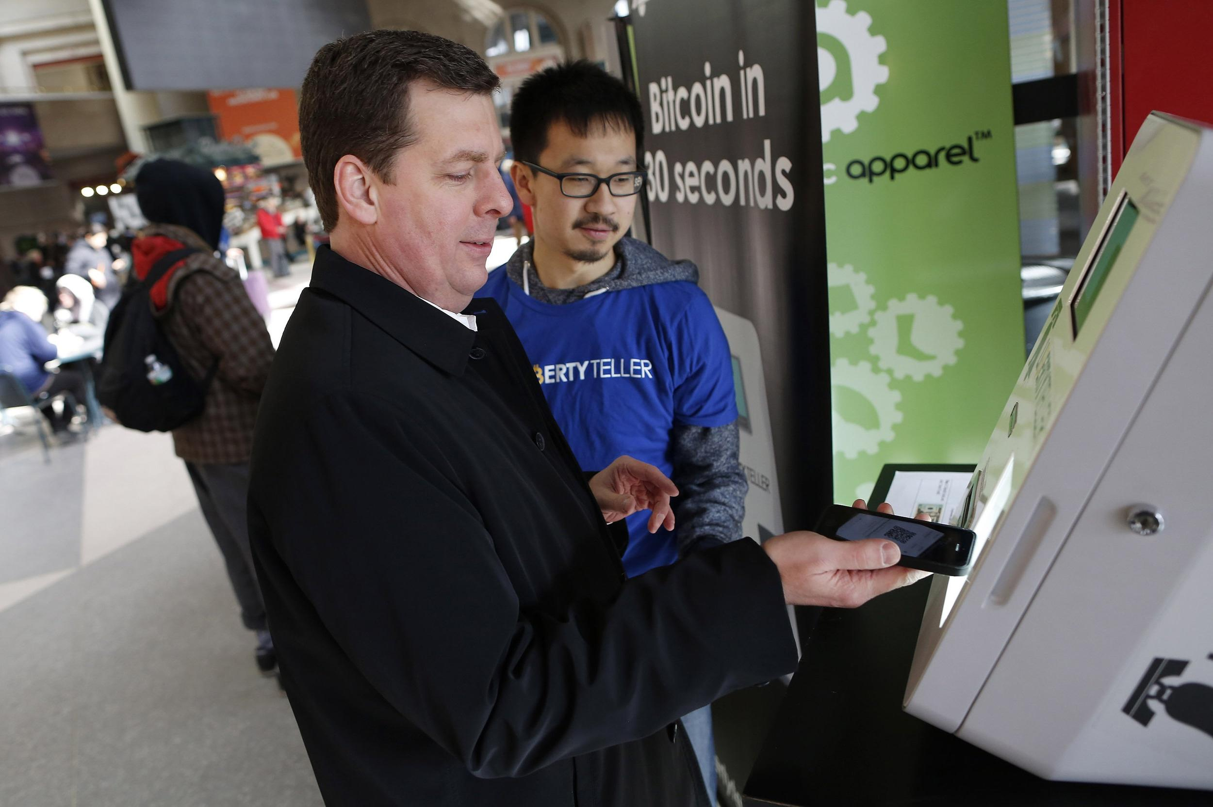 Image: Dave Mitchell purchases bitcoin at the Liberty Teller kiosk at South Station in Boston