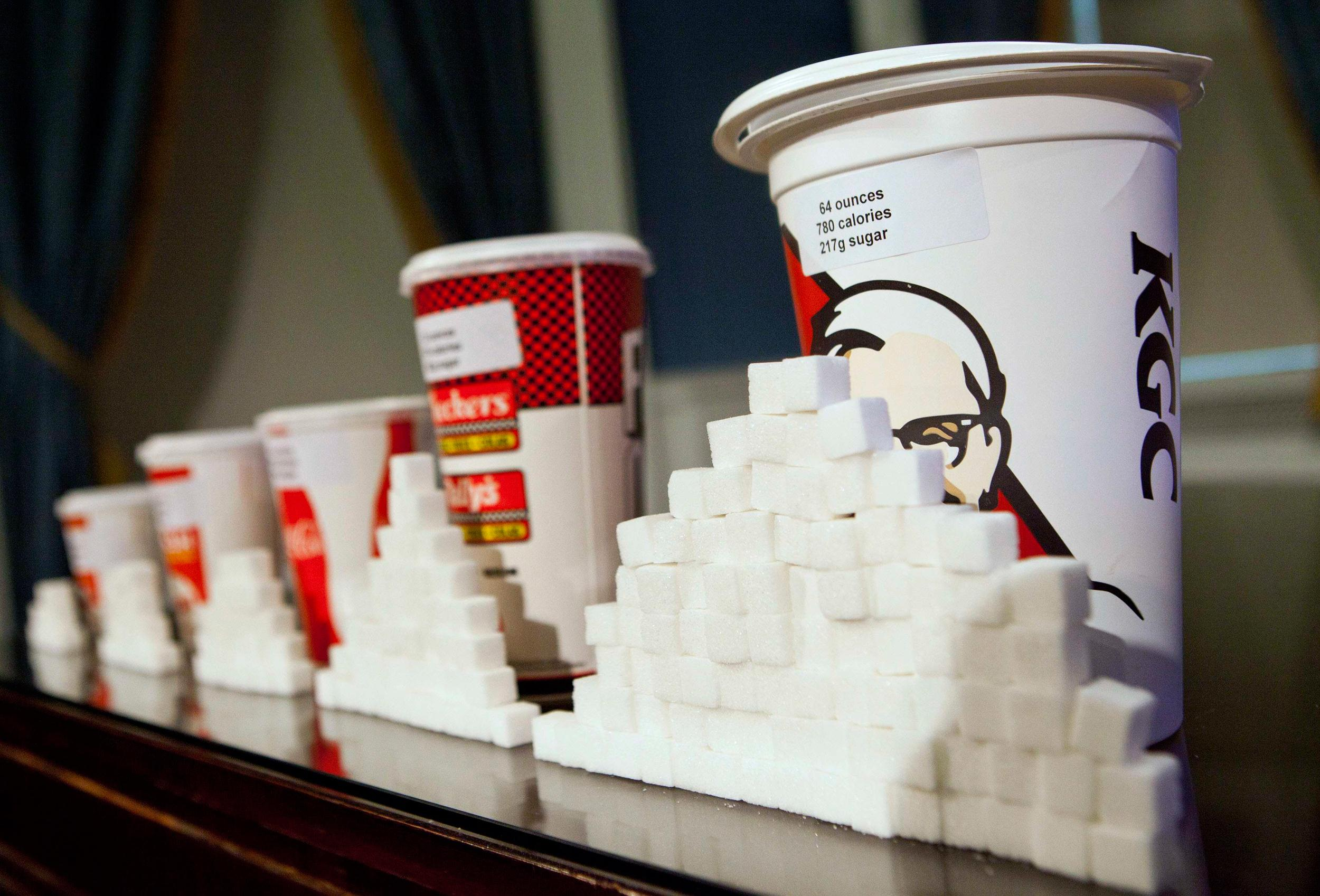 Image: A 64-ounce drink is displayed alongside sugar cubes.