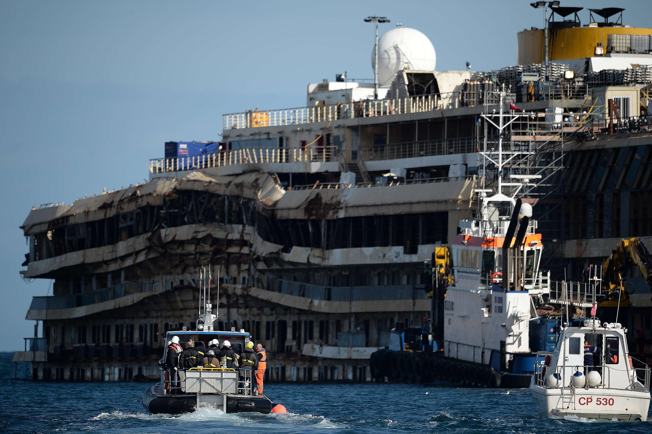 Image: Costa Concordia cruise ship captain Francesco Schettino returns to the wrecked Costa Concordia for the first time.