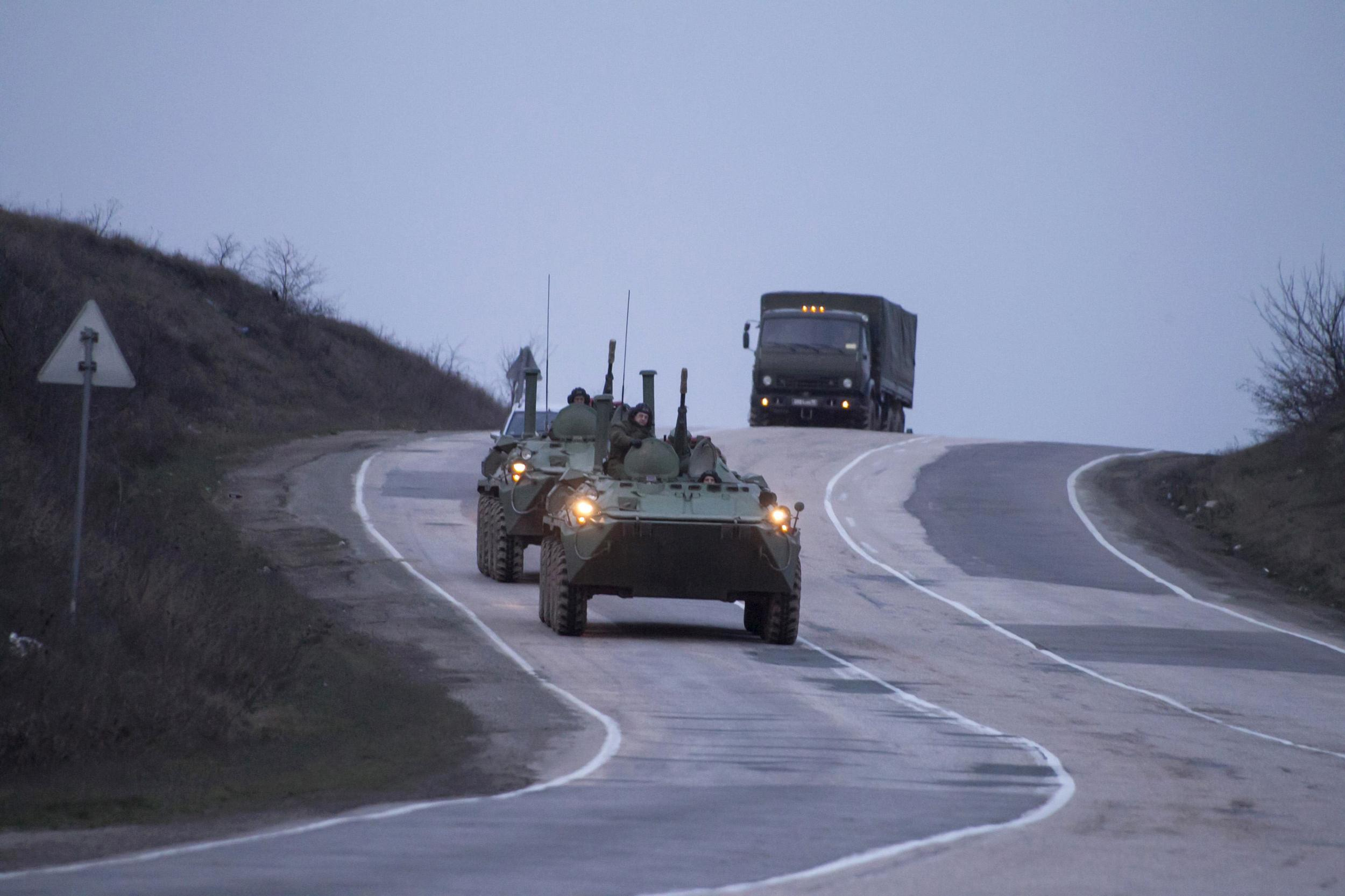 Image: Russian military armored personnel carriers (APC) drive on the road from Sevastopol to Simferopol