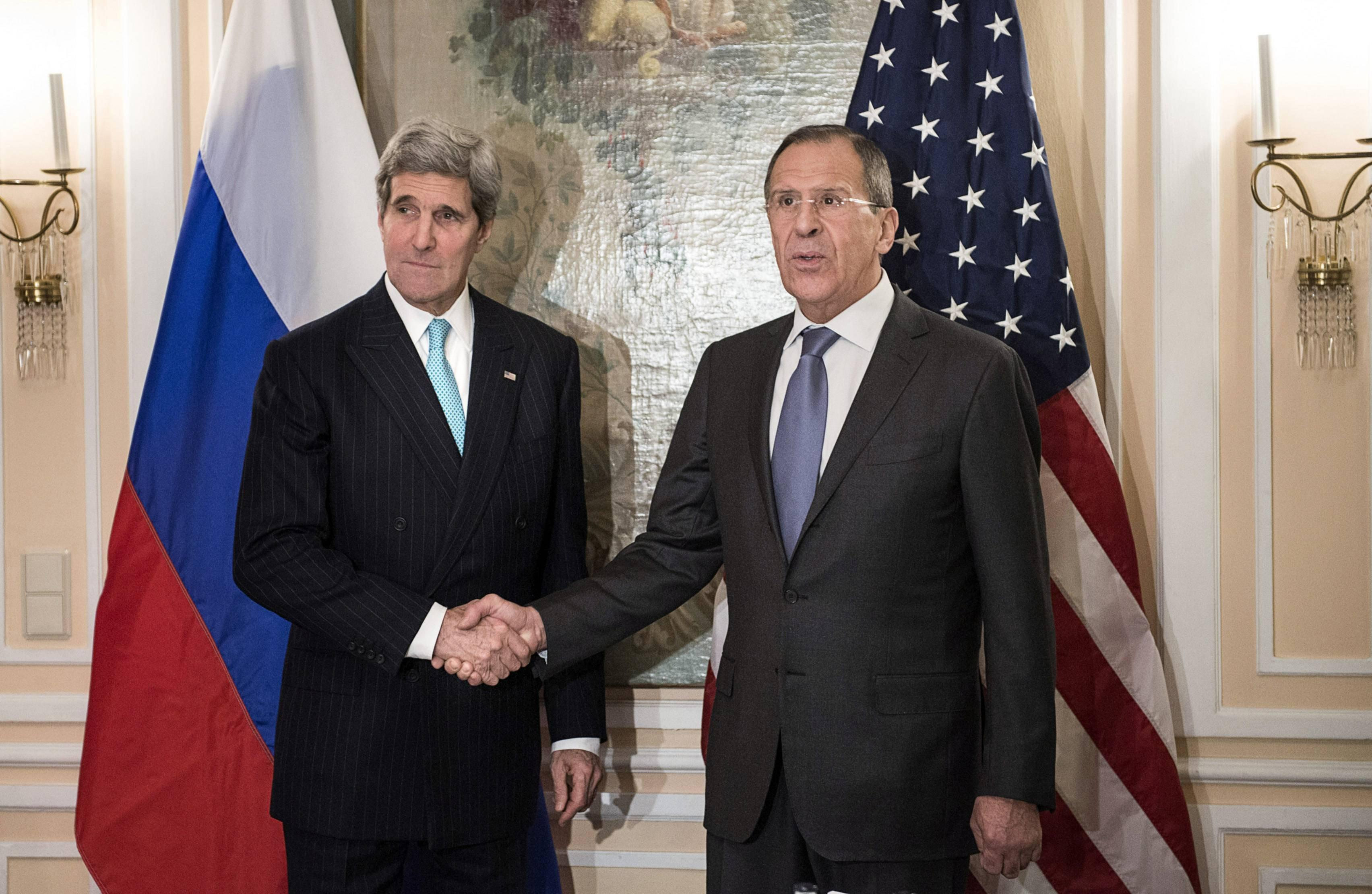 Image: U.S. Secretary of State John Kerry and Russian Foreign Minister Sergei Lavrov shake hands