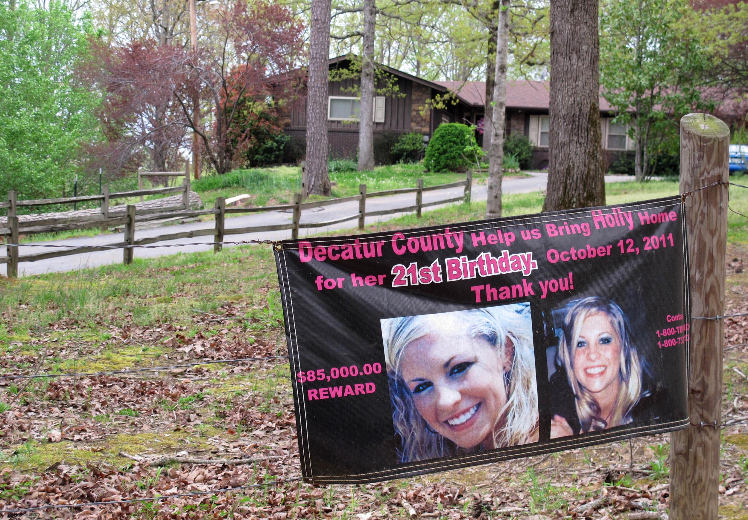 Image: A poster with the face of missing Tennessee nursing student Holly Bobo