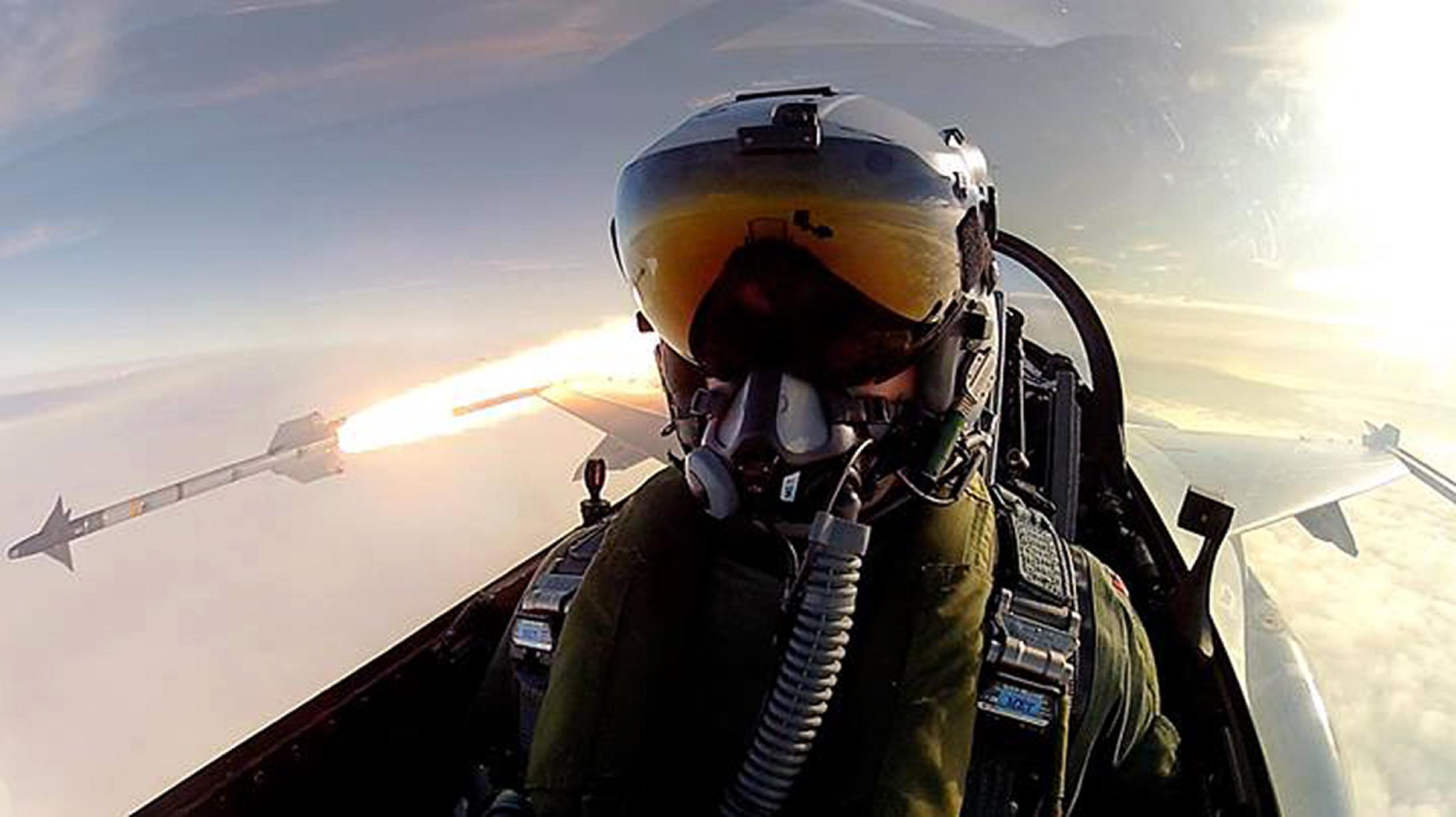 Royal Danish Air Force pilot Thomas Kristensen fires an AIM-9L air-to-air missile from his F-16 Fighting Falcon.