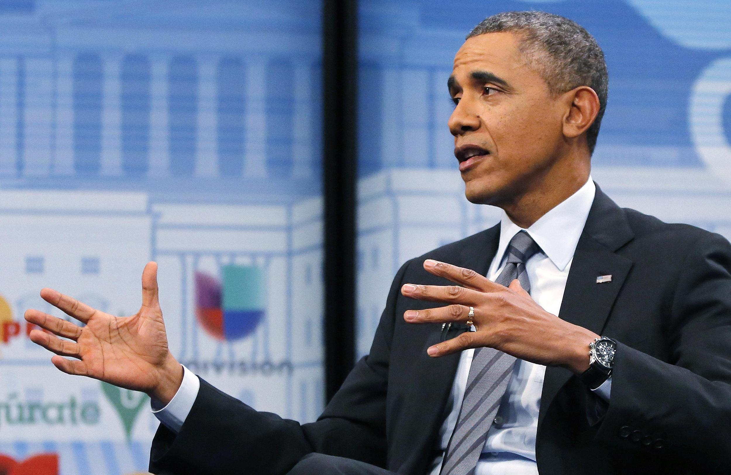 Image: President Obama participates in a town hall-style forum to encourage Latino Americans to enroll in Obamacare health insurance plans, at the Newseum in Washington