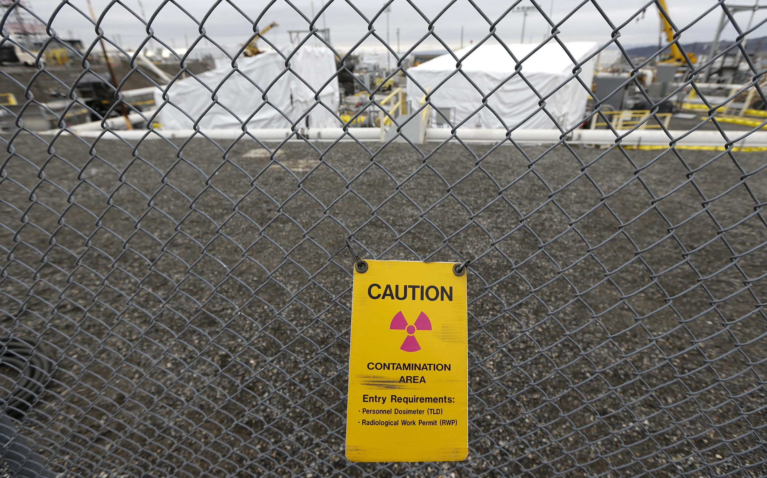 Image: A warning sign is attached to a fence at the 'C' Tank Farm at the Hanford Nuclear Reservation, near Richland, Wash.