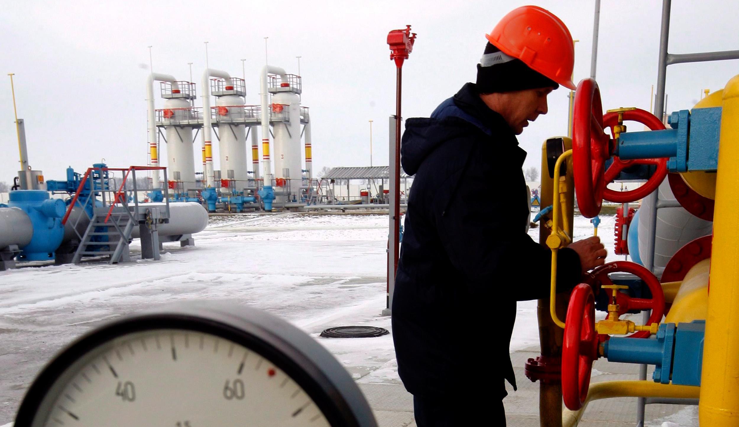 Image: A Ukrainian worker turns off a tap at the new gas-compressor station 'Bobrovnytska' in Mryn village