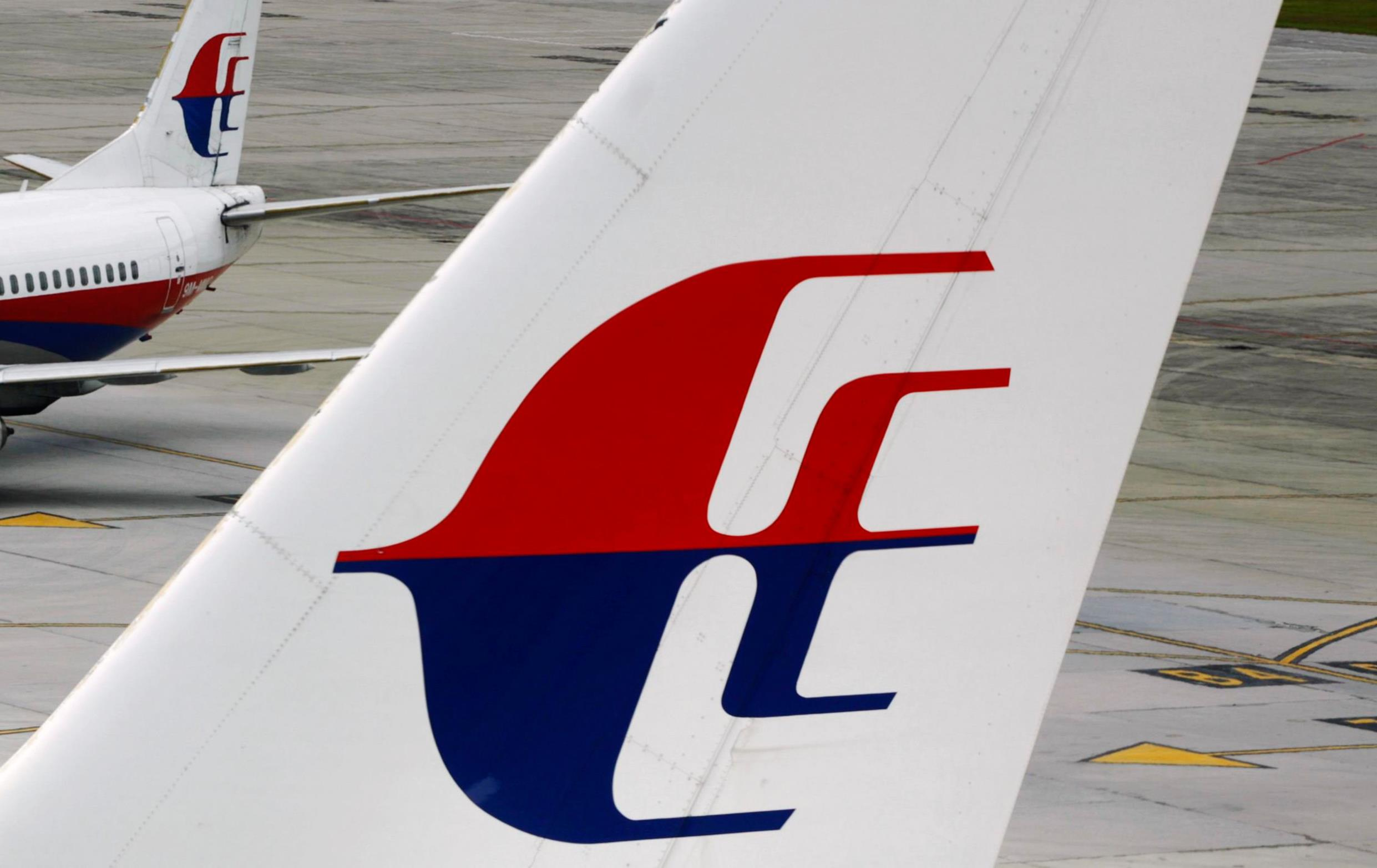 Image: The logo of Malaysia Airlines is seen on two aircraft on the tarmac at Kuala Lumpur International Airport in Sepang