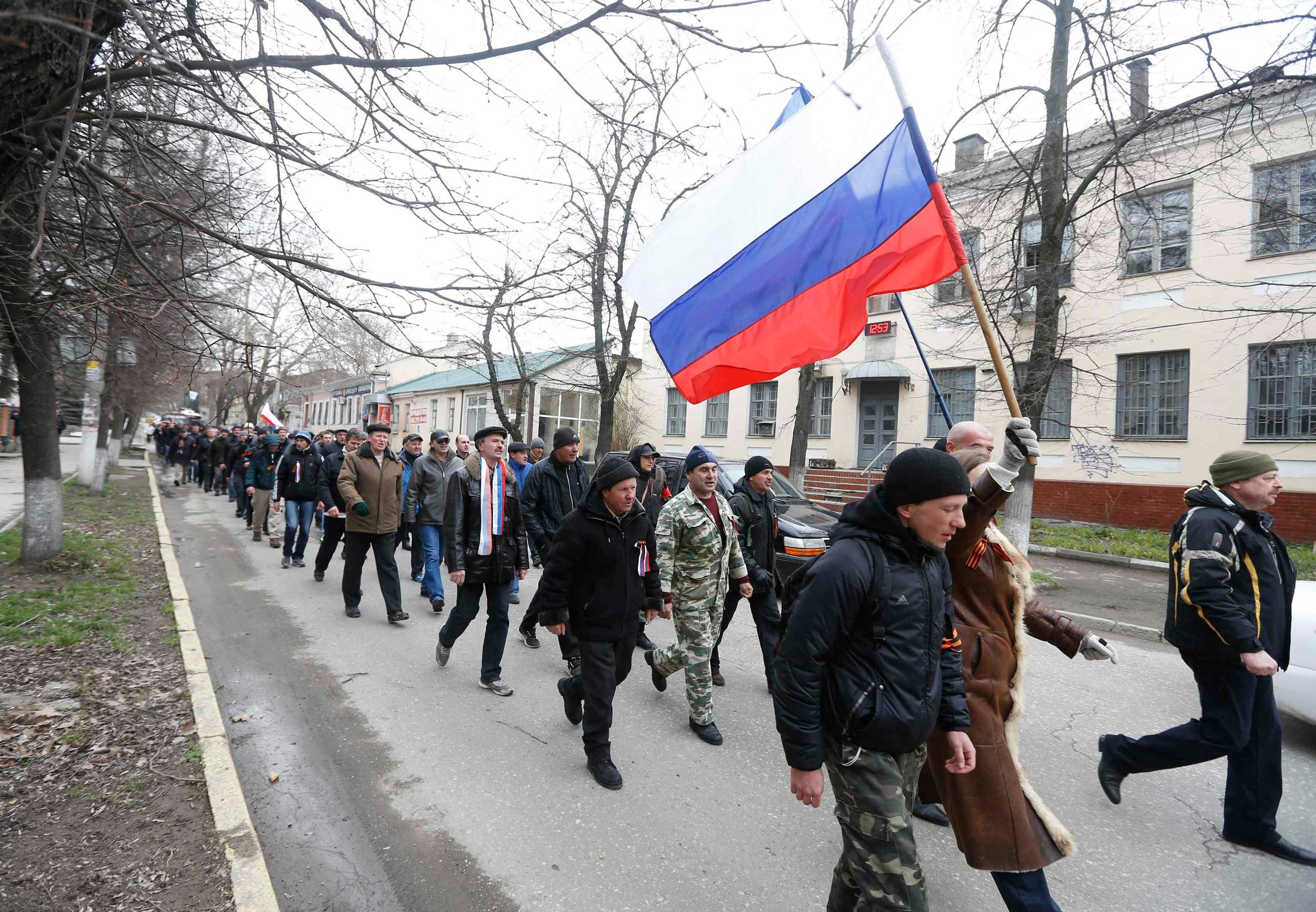 Image: Pro-Russian supporters march with the Russian flag during a rally in Simferopol