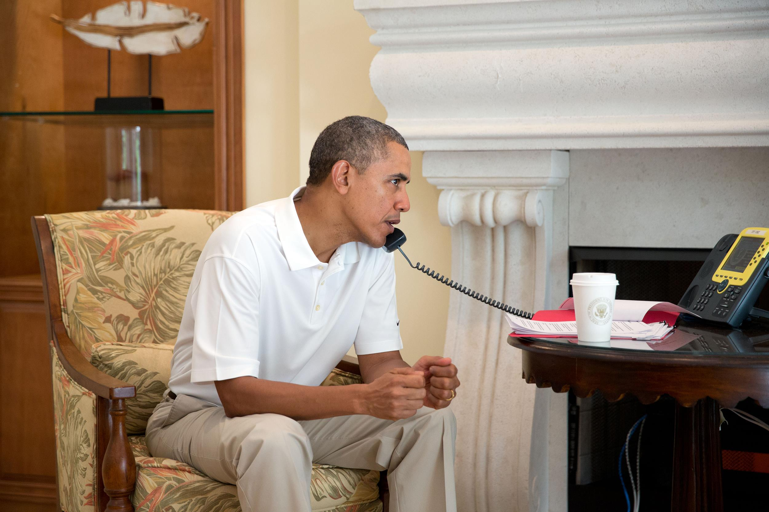 Image: President Barack Obama talks on the telephone with President Francois Hollande of France to discuss the situation in Ukraine