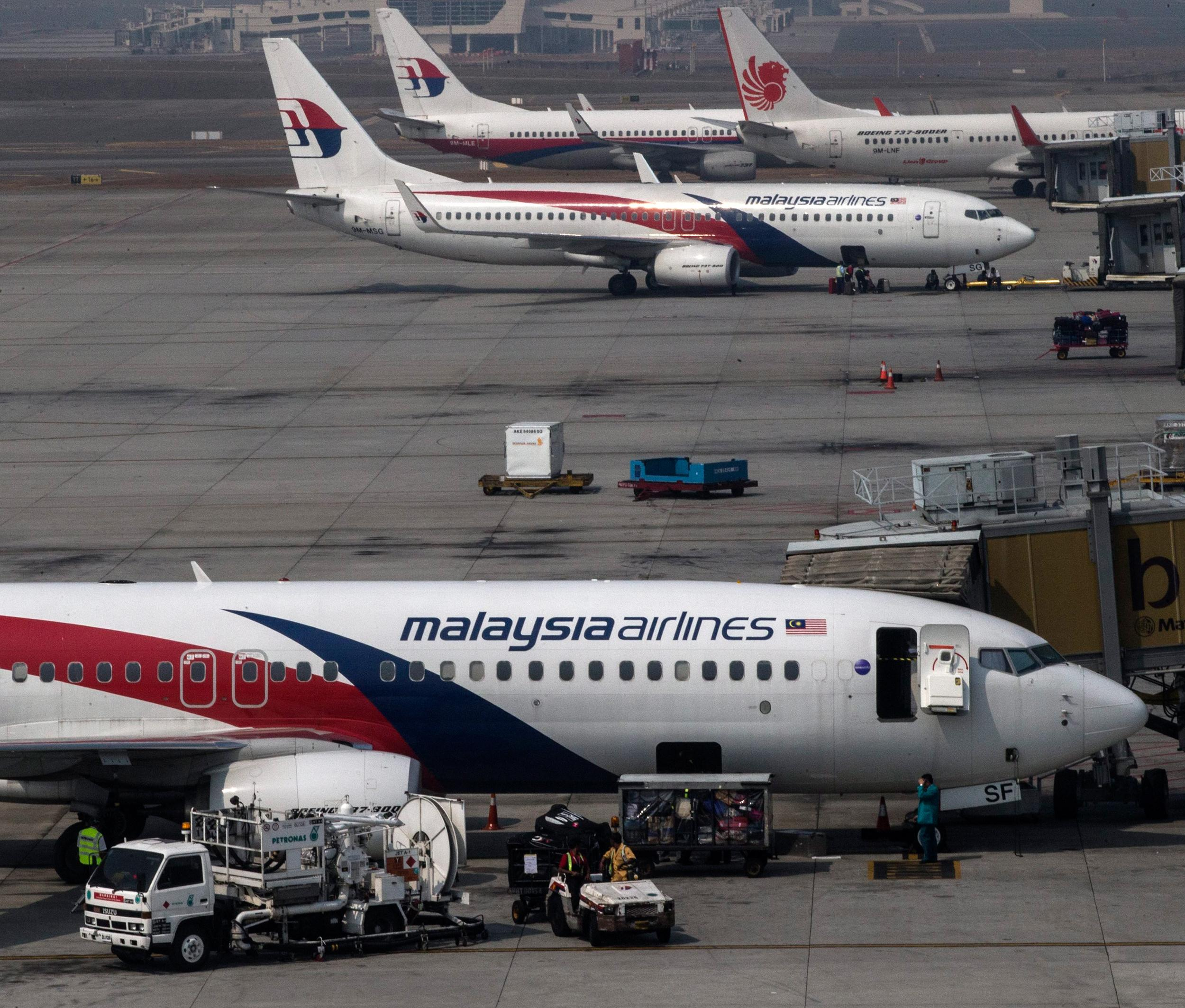Image: Malaysian Airlines airplanes are parked at gates at Kuala Lumpur International Airport on March 9.
