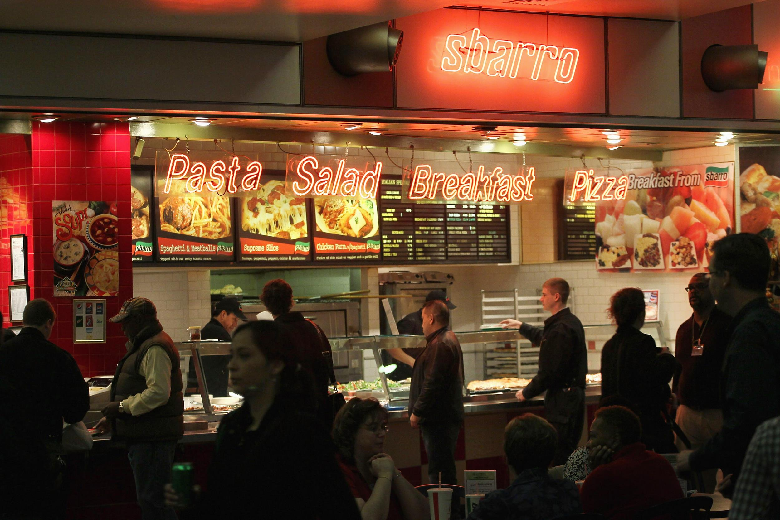 Customers order lunch at a Sbarro restaurant on April 4, 2011 in Chicago, Illinois.