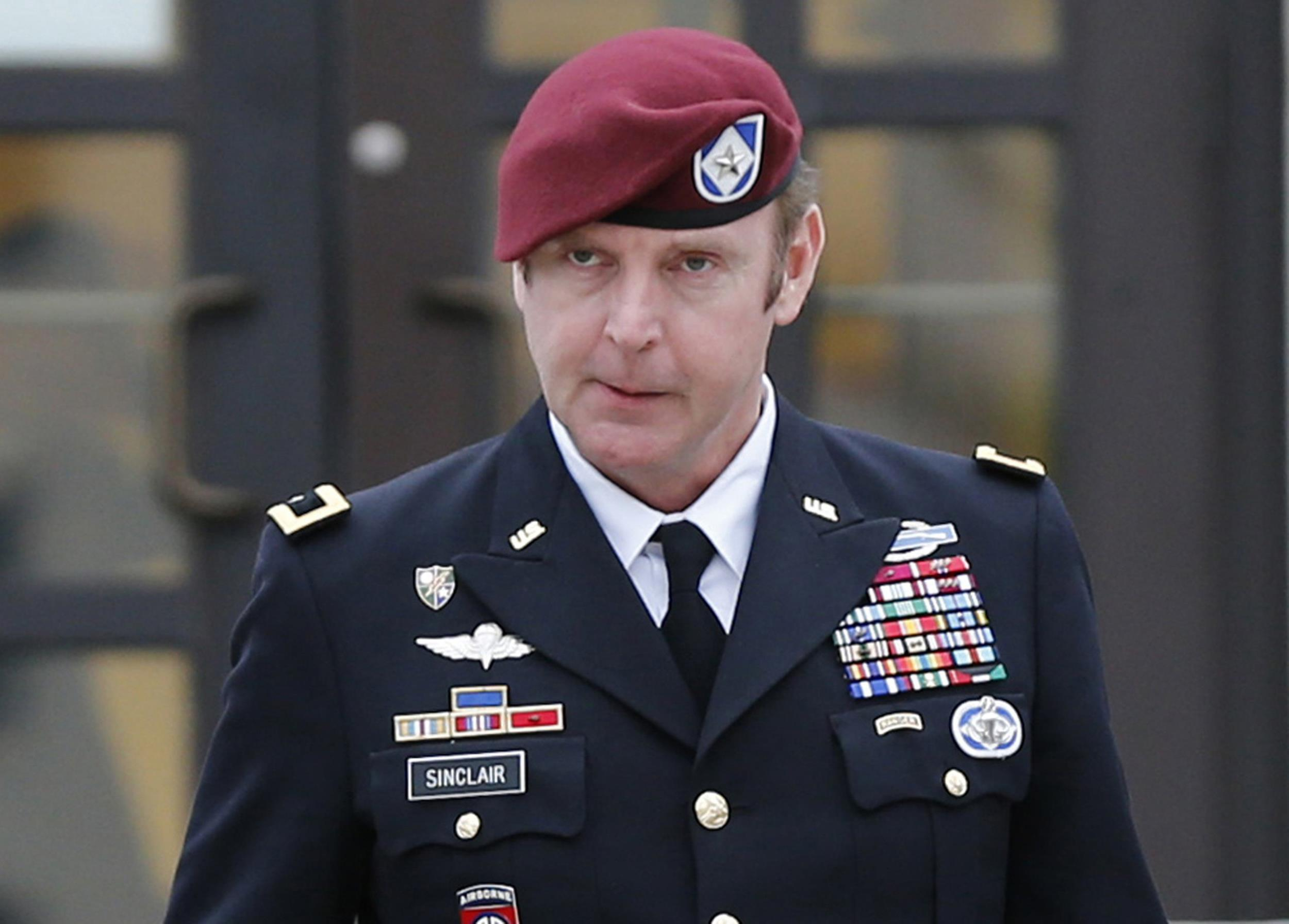 Image: U.S. Army Brigadier General Sinclair leaves the courthouse at Fort Bragg in Fayetteville, N.C., on March 4.
