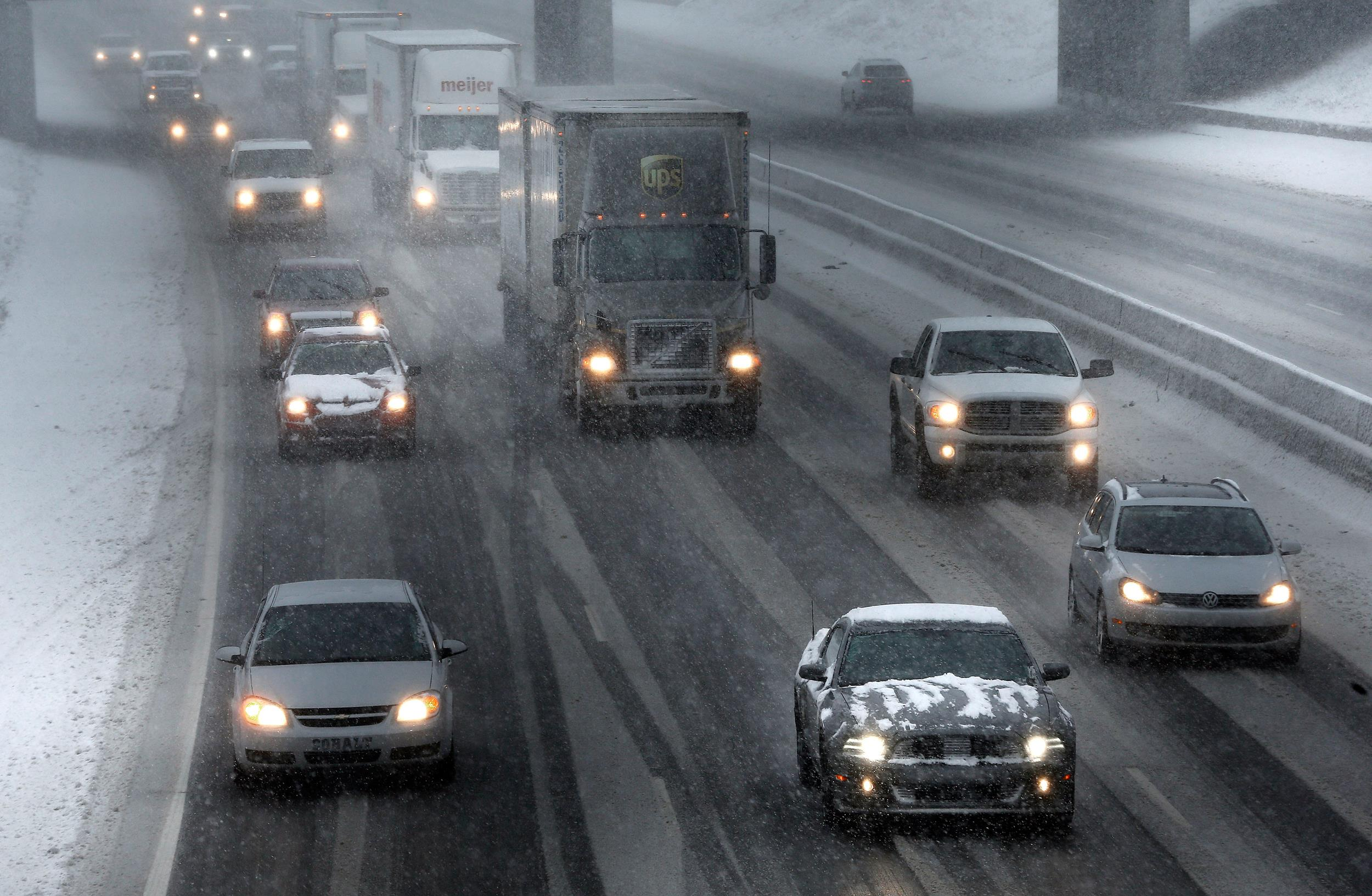 Image: Traffic moves on Interstate 94 during a snow storm in Detroit, Wednesday