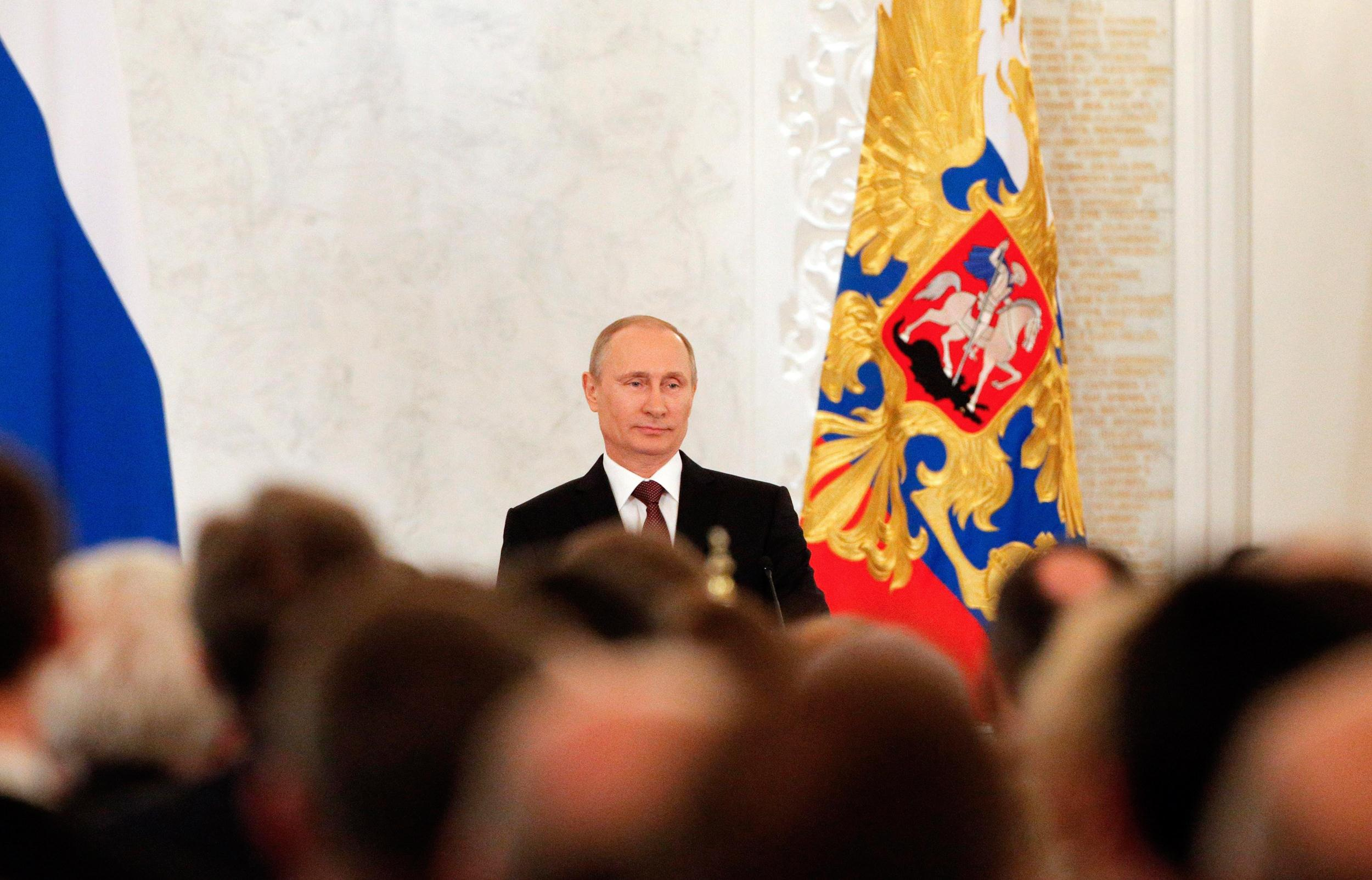 Image: Russian President Vladimir Putin addresses the Federal Assembly at the Kremlin in Moscow
