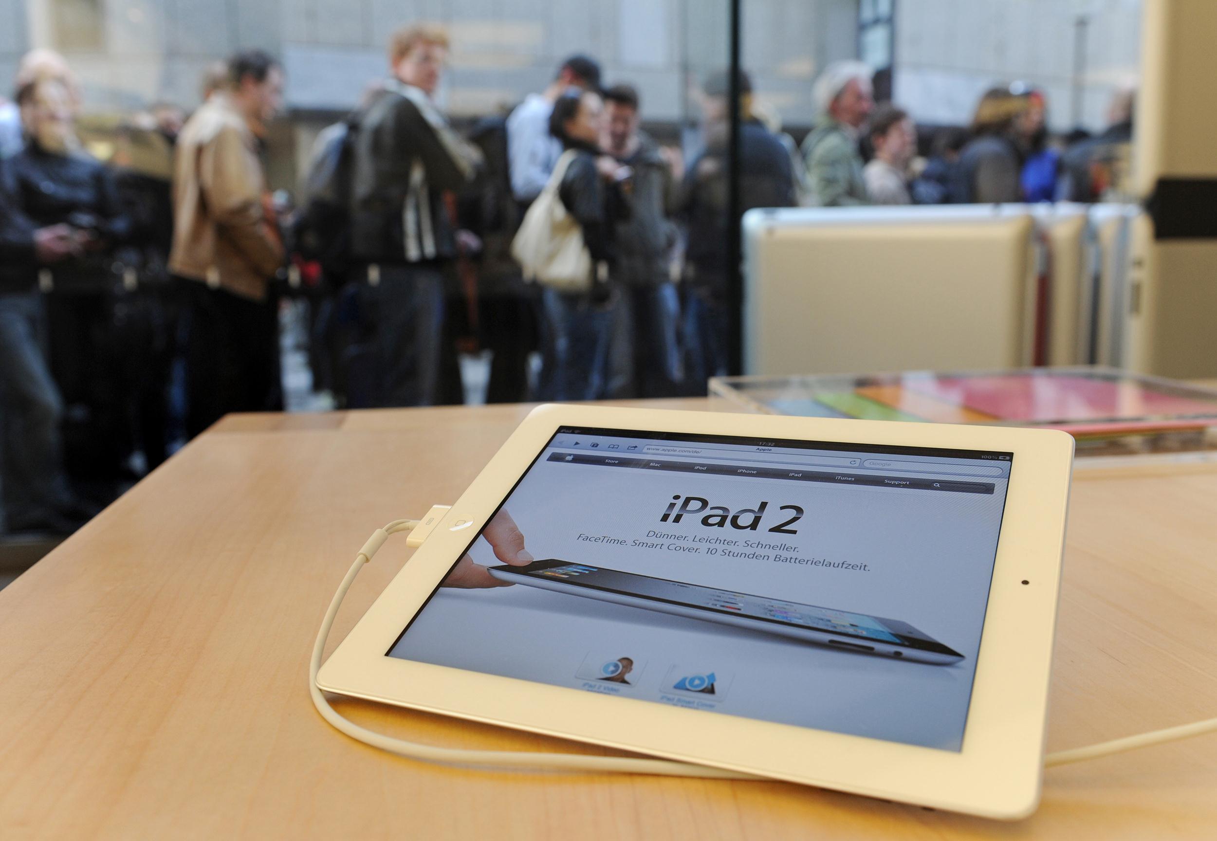 Customers wait to buy the new Apple iPad