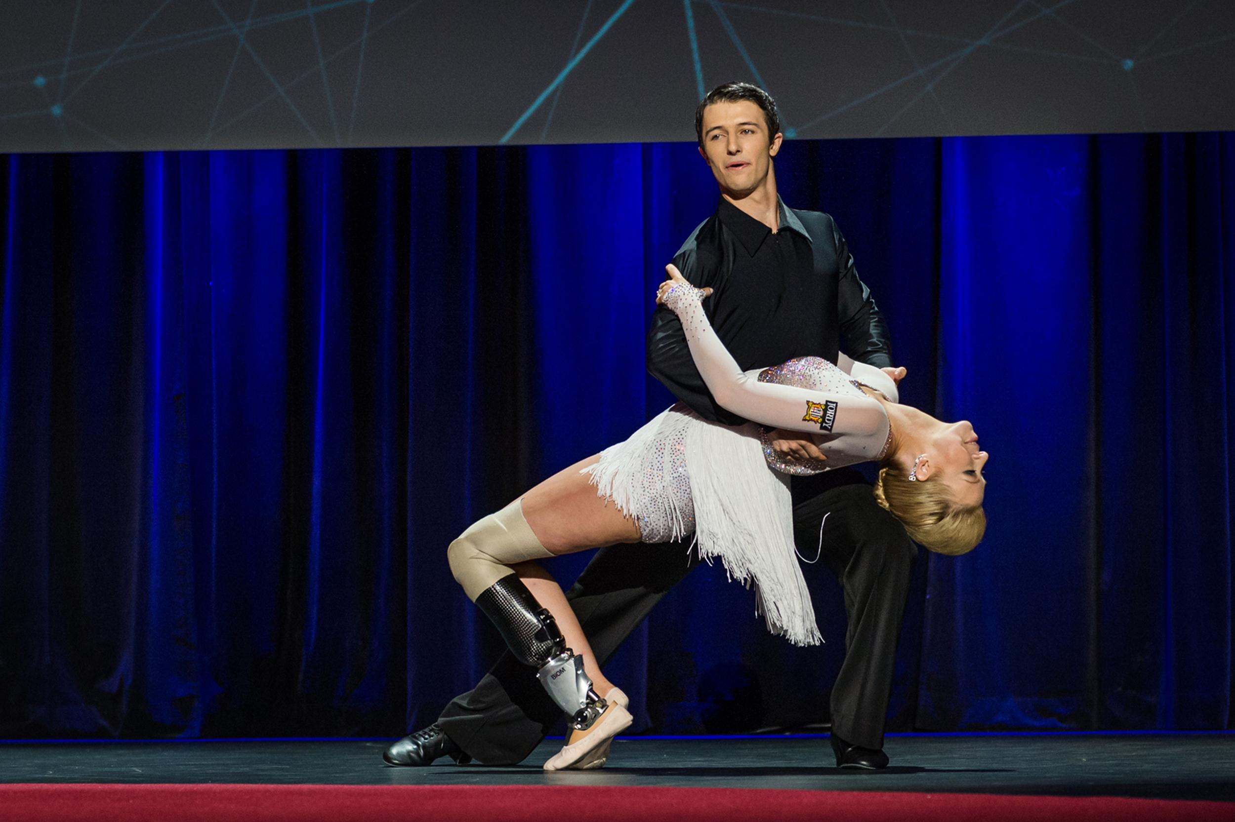 Image: Dancer Christian Lightner, dips Boston Marathon bombing survivor Adrianne Haslet-Davis as they dance at the international TED 2014 conference at the  Vancouver Convention Center
