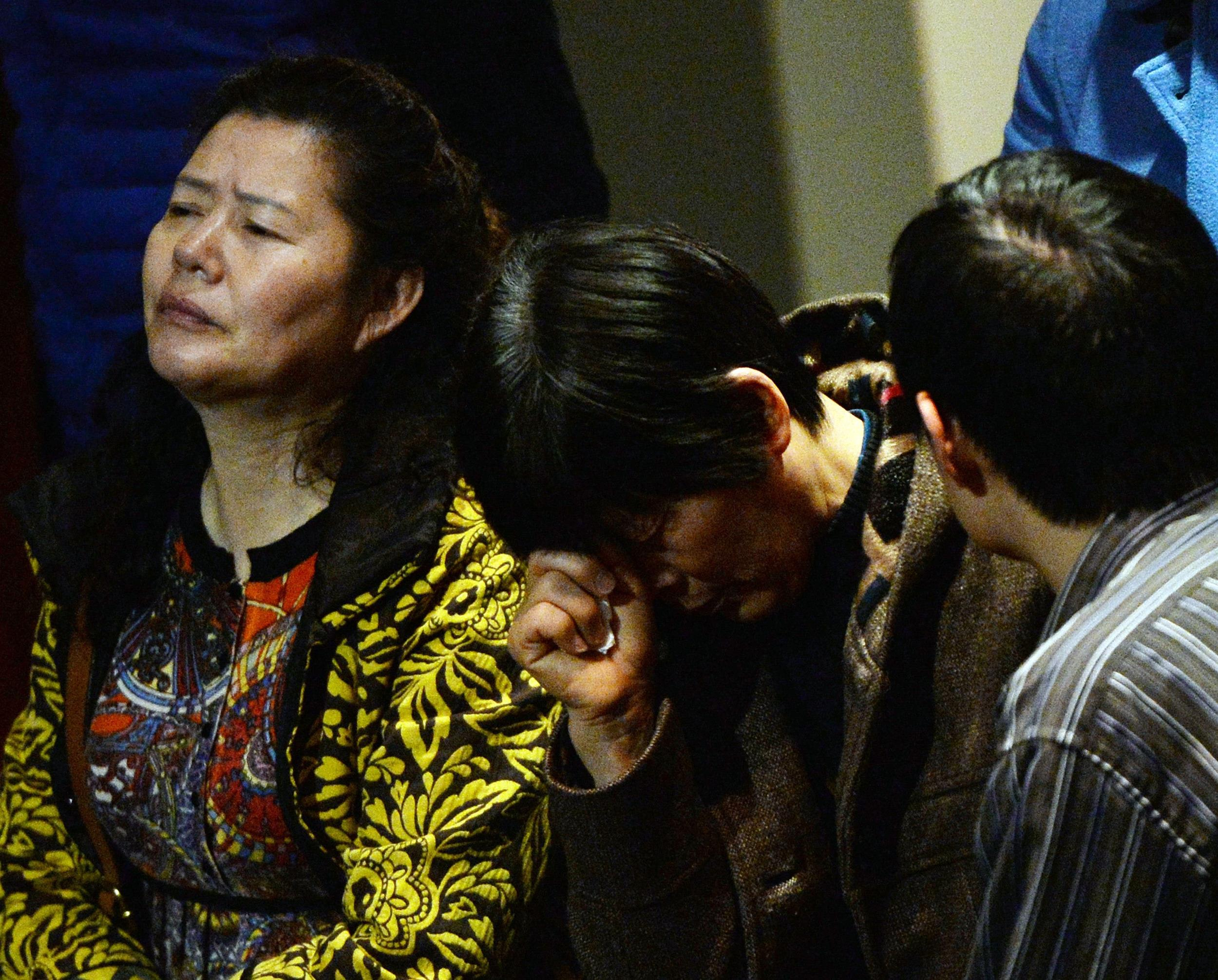 Image: Chinese relatives of passengers from the missing Malaysia Airlines flight MH370