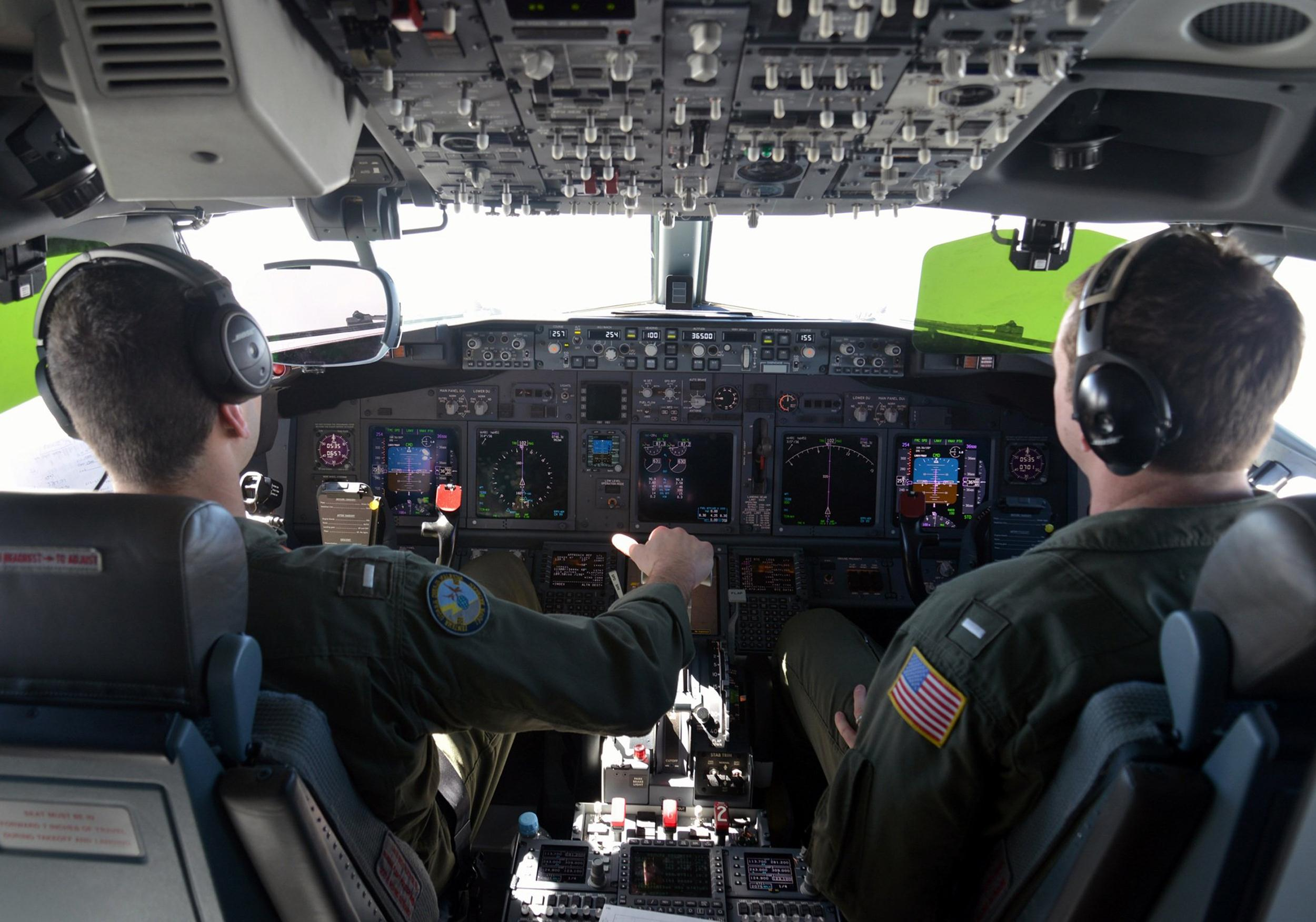 Image: US Naval pilots attached to Patrol Squadron (VP) 16, fly a P-8A Poseidon during a mission over the Indian Ocean to assist in search and rescue operations for Malaysia Airlines flight MH370