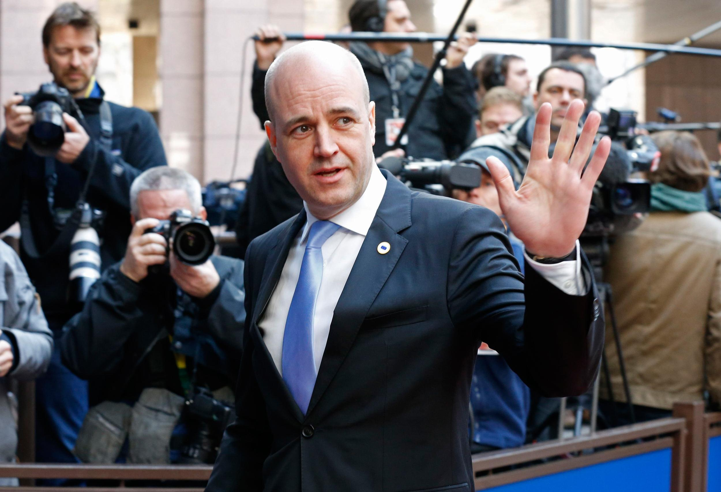 Image: Sweden's Prime Minister Fredrik Reinfeldt arrives at a European leaders emergency summit on the situation in Ukraine, in Brussels