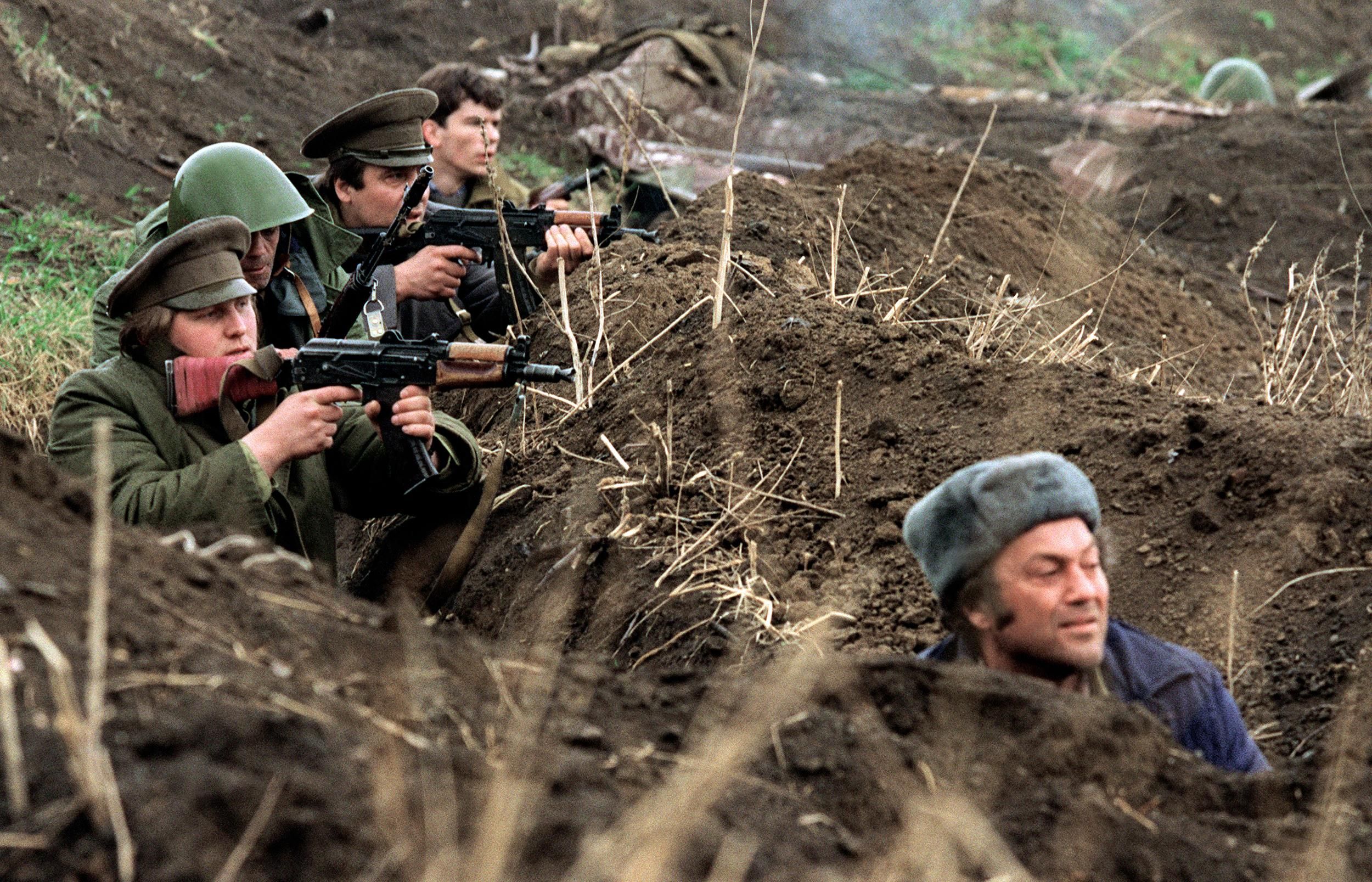 Image: Russian-speaking fighters of the newly proclaimed Trans-Dniester Republic and Cossacks shoot towards Moldovan soldiers on March 30, 1992