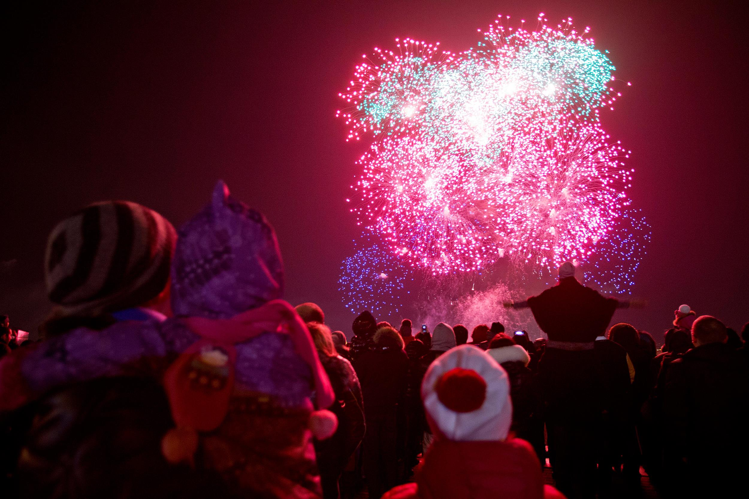 Image: Fireworks illuminate the sky marking the incorporation of the Black Sea peninsula, Crimea, into Russia in Moscow