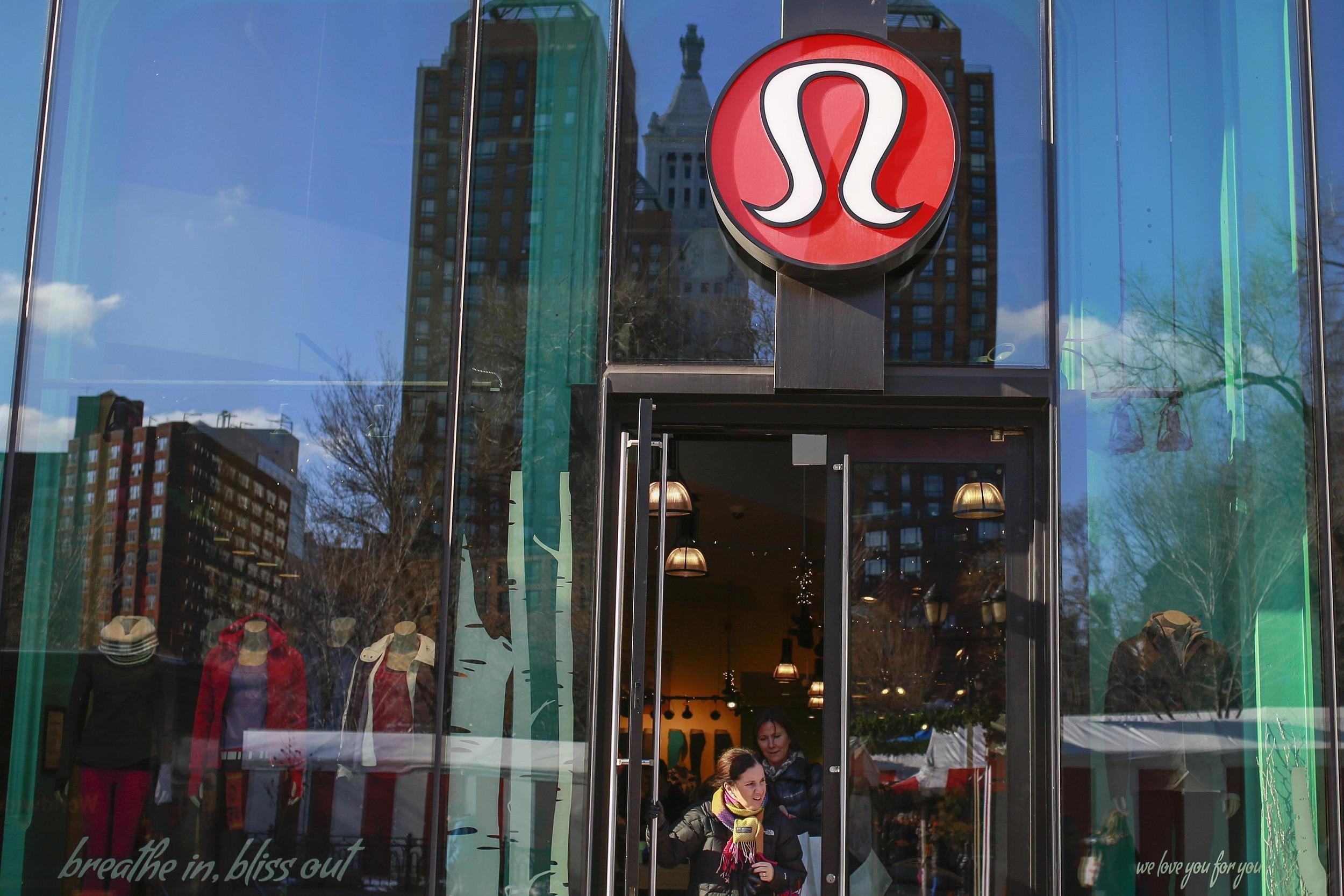 Shopper walks out of the lululemon athletica store in new york