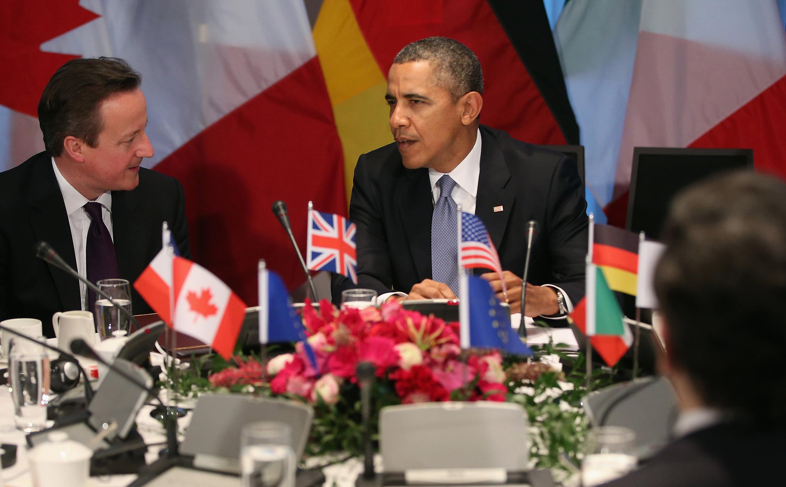 Image:  U.S. President Barack Obama chats with other G7 leaders