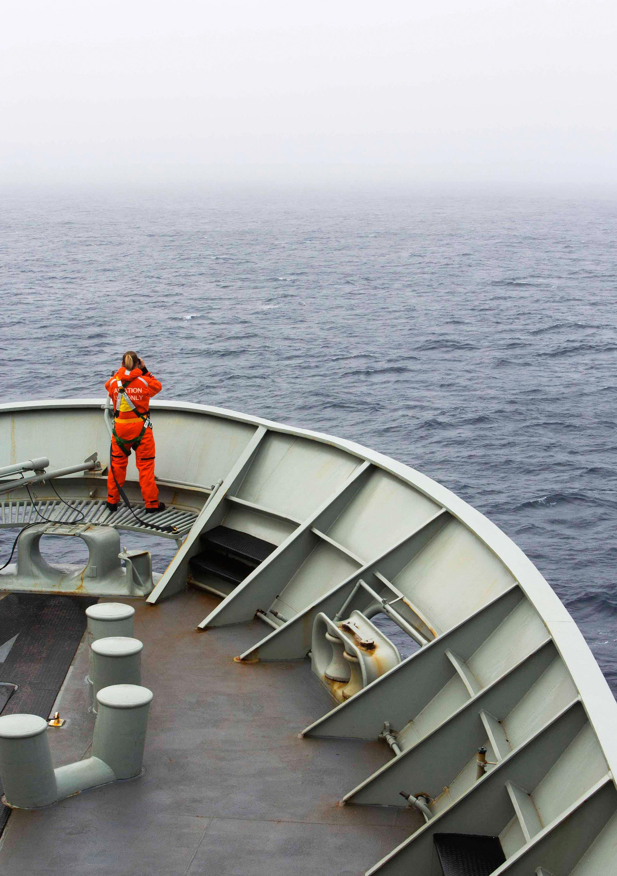 Image: A lookout is stationed on bow of HMAS Success during the search in the southern Indian Ocean for signs of the missing Malaysia Airlines Flight MH370.