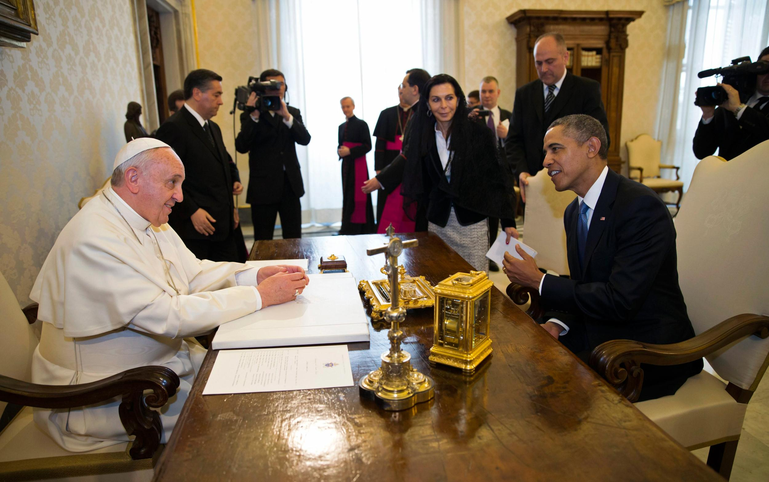 Image: President Obama talks to Pope Francis at the Vatican