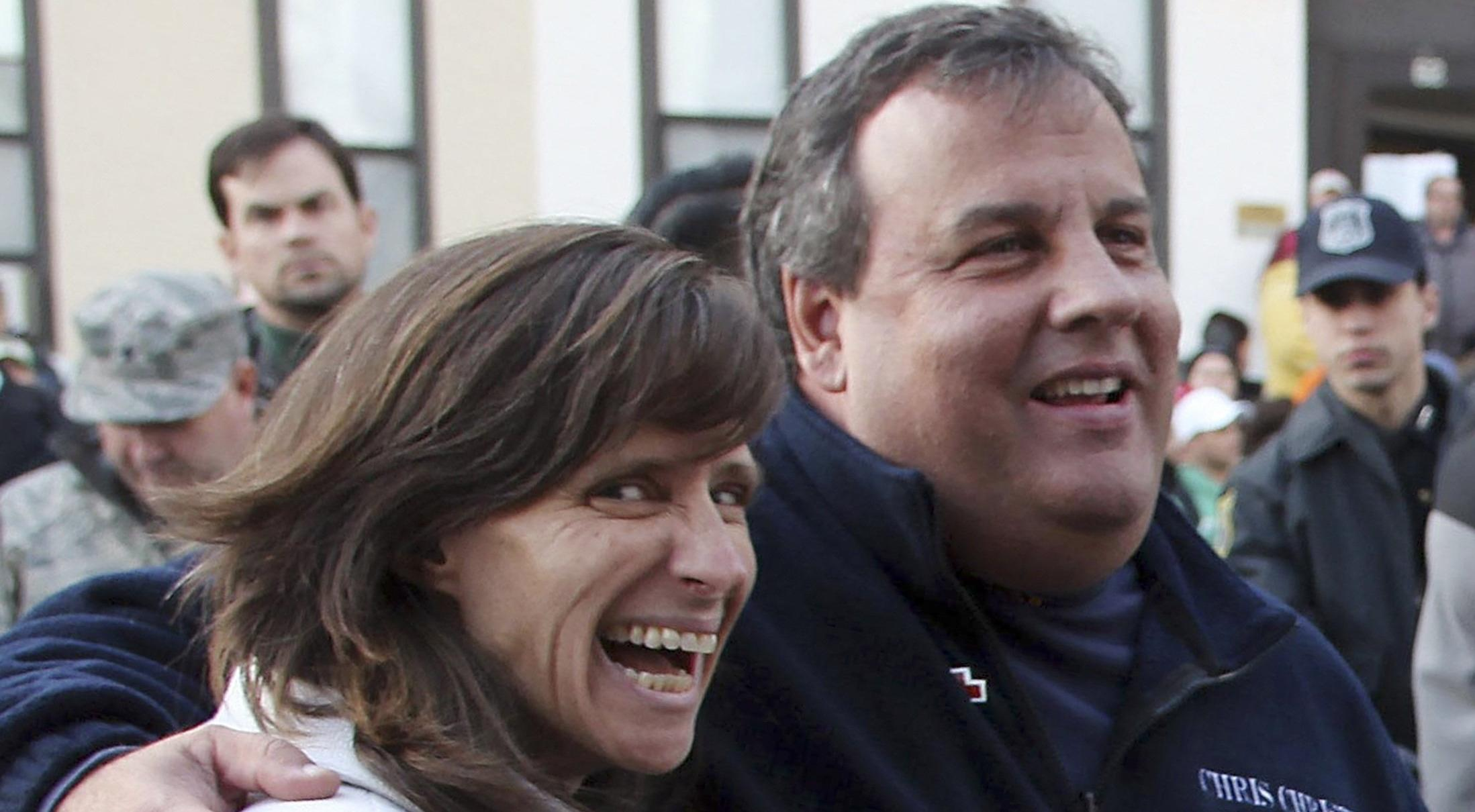 Image: Handout file photo of New Jersey Governor Christie and Hoboken Mayor Zimmer speaking with volunteers in Hoboken